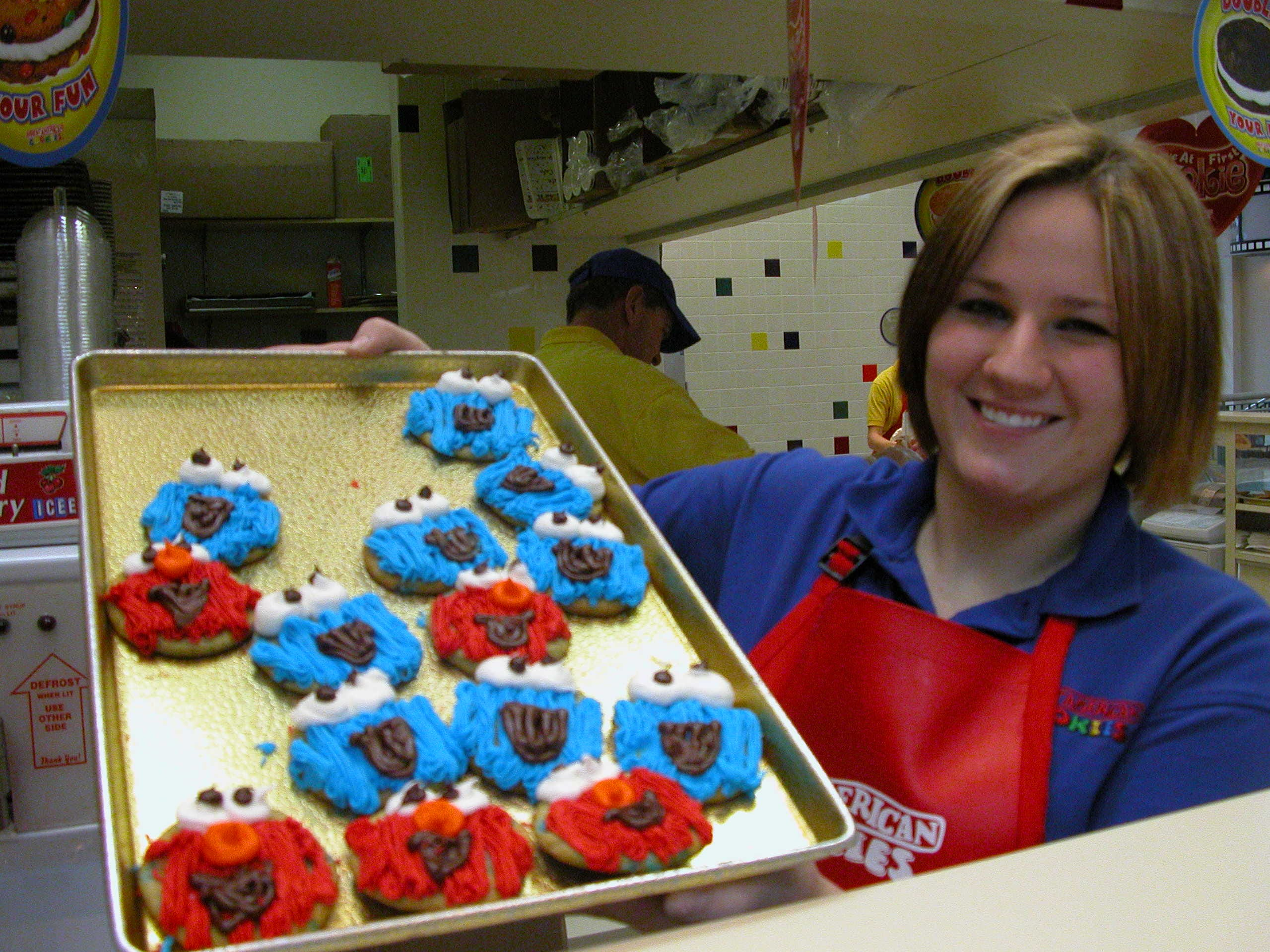 Ashley Trent serves up Cookie Monster and Elmo cookies at West Town Mall.