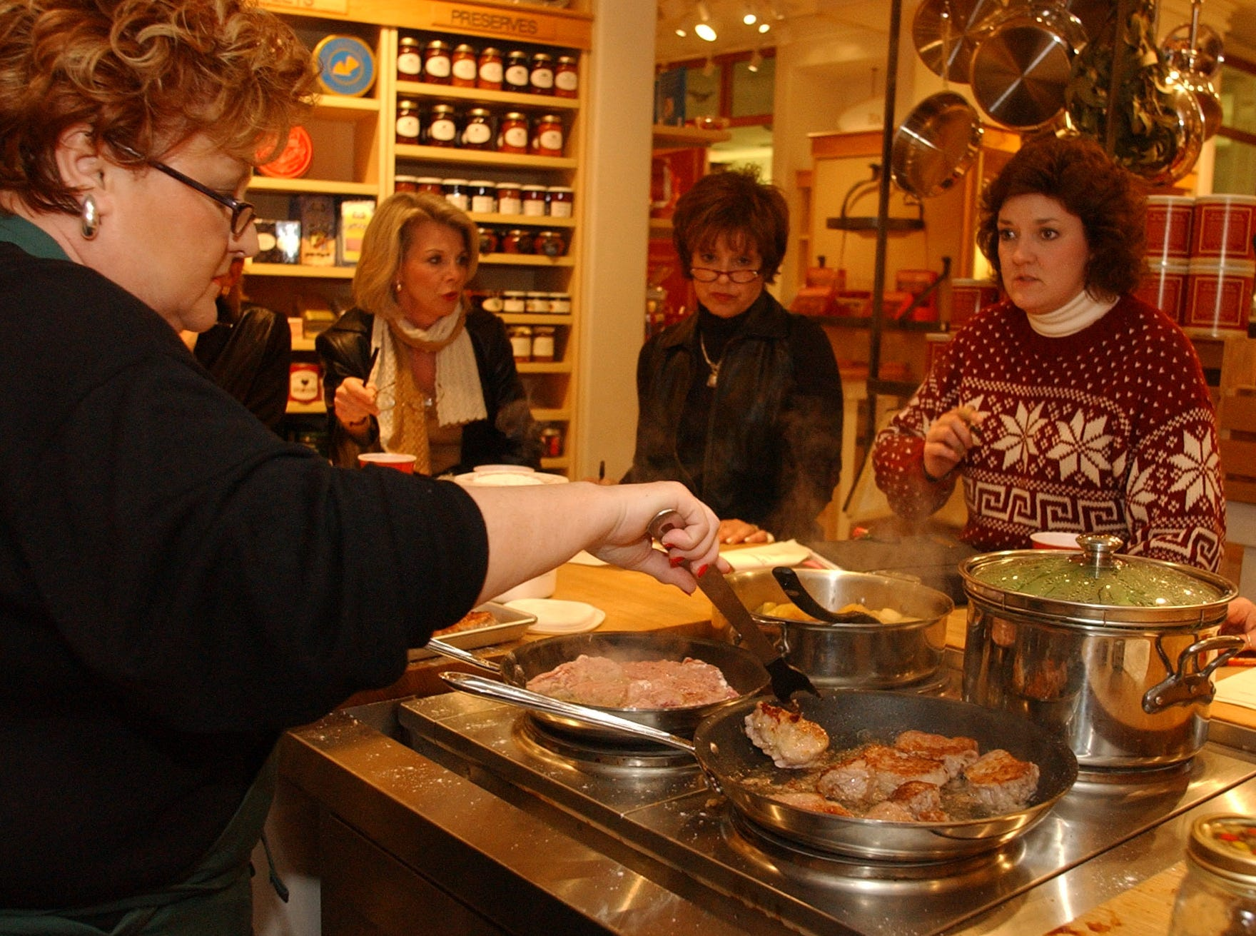 0124veal.1.CC--living---Barbara  Tenney at the Williams-Sonoma stoer in West Towne Mall demonstrates how to cook veal during a cooking class held recently at the store. From left Debbie Diddle, Sandy Love and Dori Miller listen and watch.  News-Sentinel staff photo by Cathy Clarke. ASA200 Image# DSC_0010.JPG