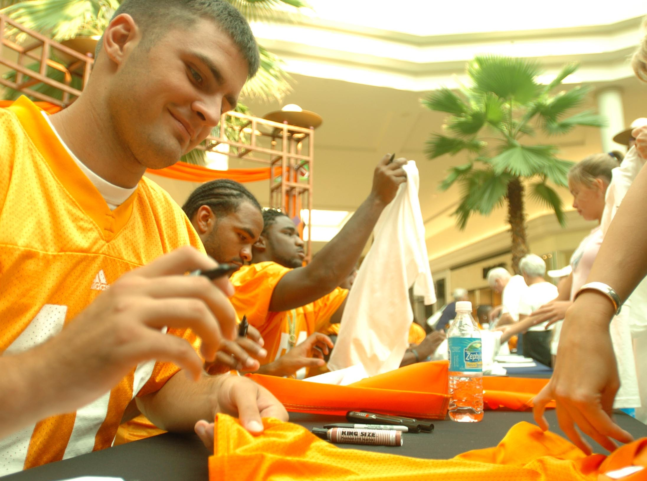 vols2.SY#4255--spt-- UT's Erik Ainge signs autographs for fans during the 2nd annual OrangeAid at West Town Mall Monday. Proceeds collected from the event will go to the Red Cross. 2005 Saul Young/News Sentinel
