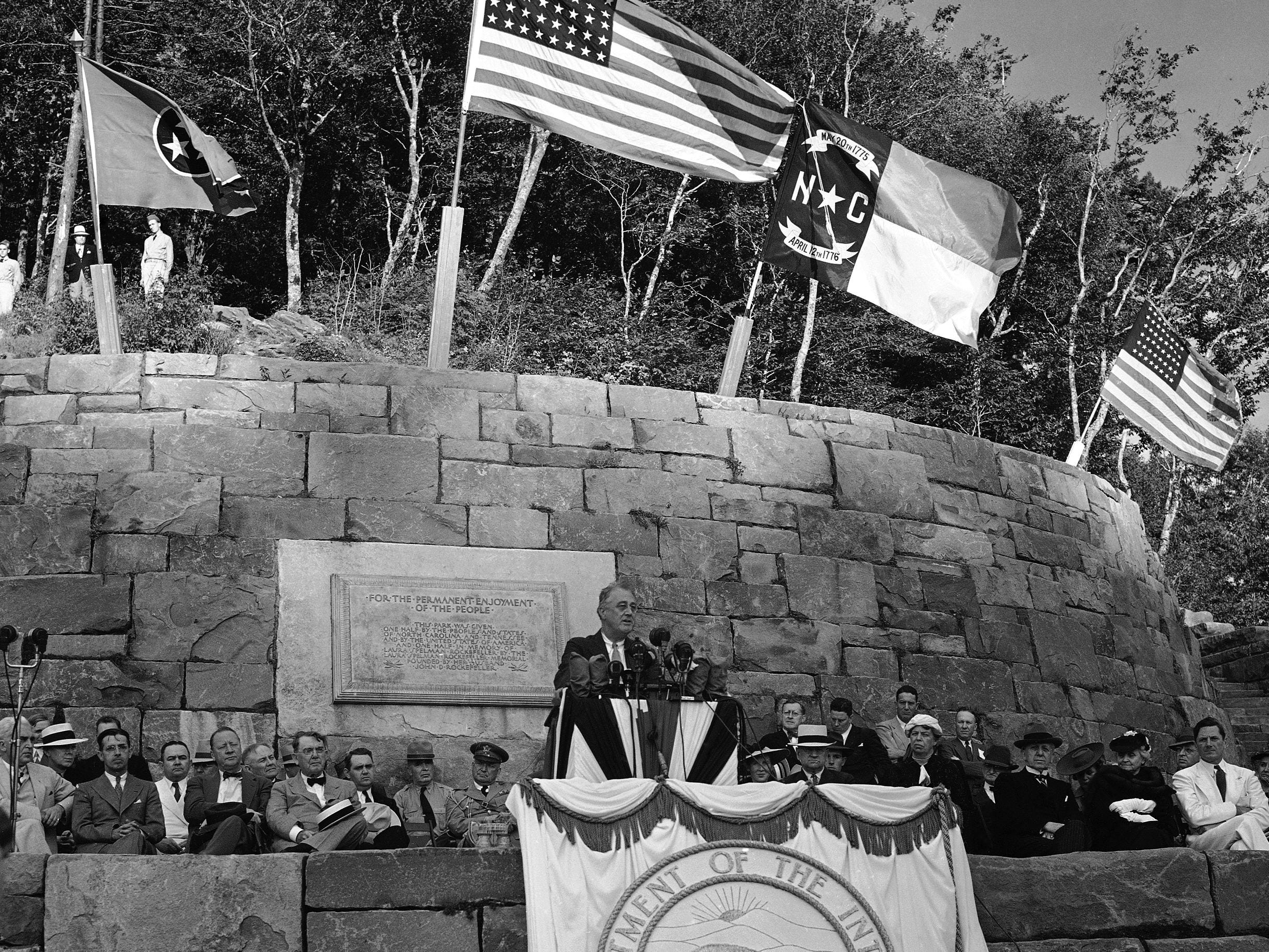 President Franklin D. Roosevelt dedicates the Great Smoky Mountains National Park at Newfound Gap on September 2, 1940. Secretary of the Interior Harold Ickes is seated just to the right of the microphones. Next to him at the right Eleanor Roosevelt. At extreme right Gov. Clyde Hoey of North Carolina. Also pictured are U.S. Sen. Robert Reynolds of North Carolina and U.S. Sen. Kenneth McKellar of Tennessee.