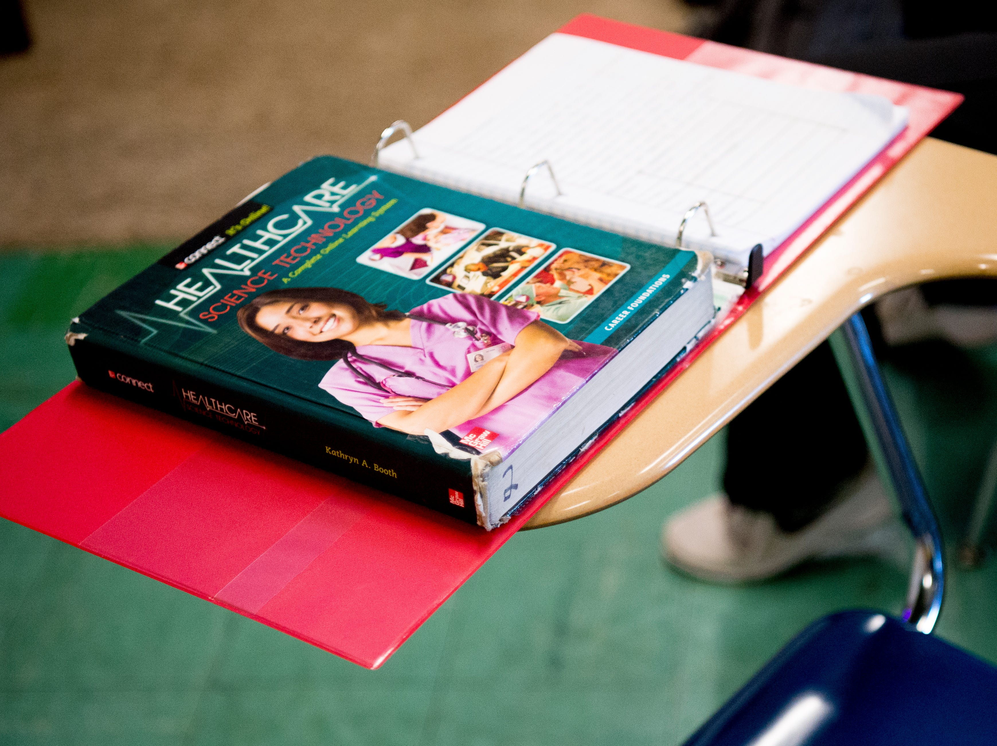 A textbook on health care science technology sits on a desk in Anita Crook's medical therapeutics class at Maryville High School in Maryville, Tennessee, on Friday, January 11, 2019. More time with teachers as well as time to study and work on homework are some of the benefits students enjoy when on block schedules.