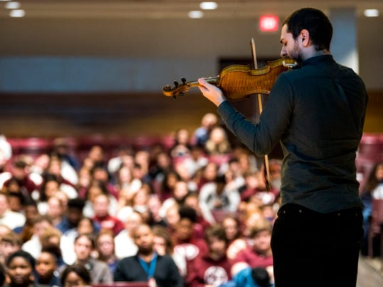 UT music student Kevork Esmeryan plays a violin from the Violins of Hope collection during a presentation at Fulton High in Knoxville.