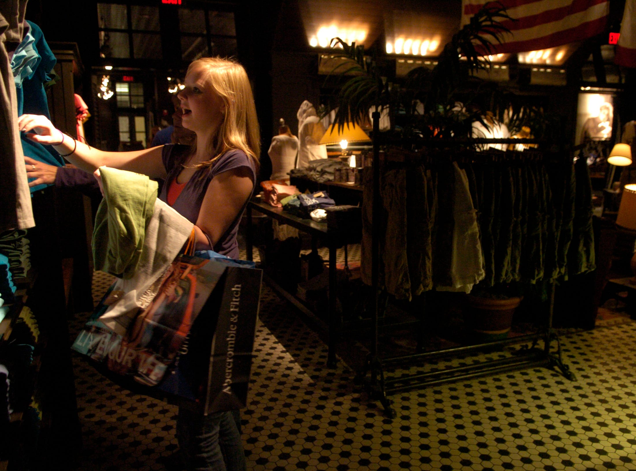 "Seventeen year-old Diana Sager shops for clothes at the ""Hollister"" store in West Town Mall."