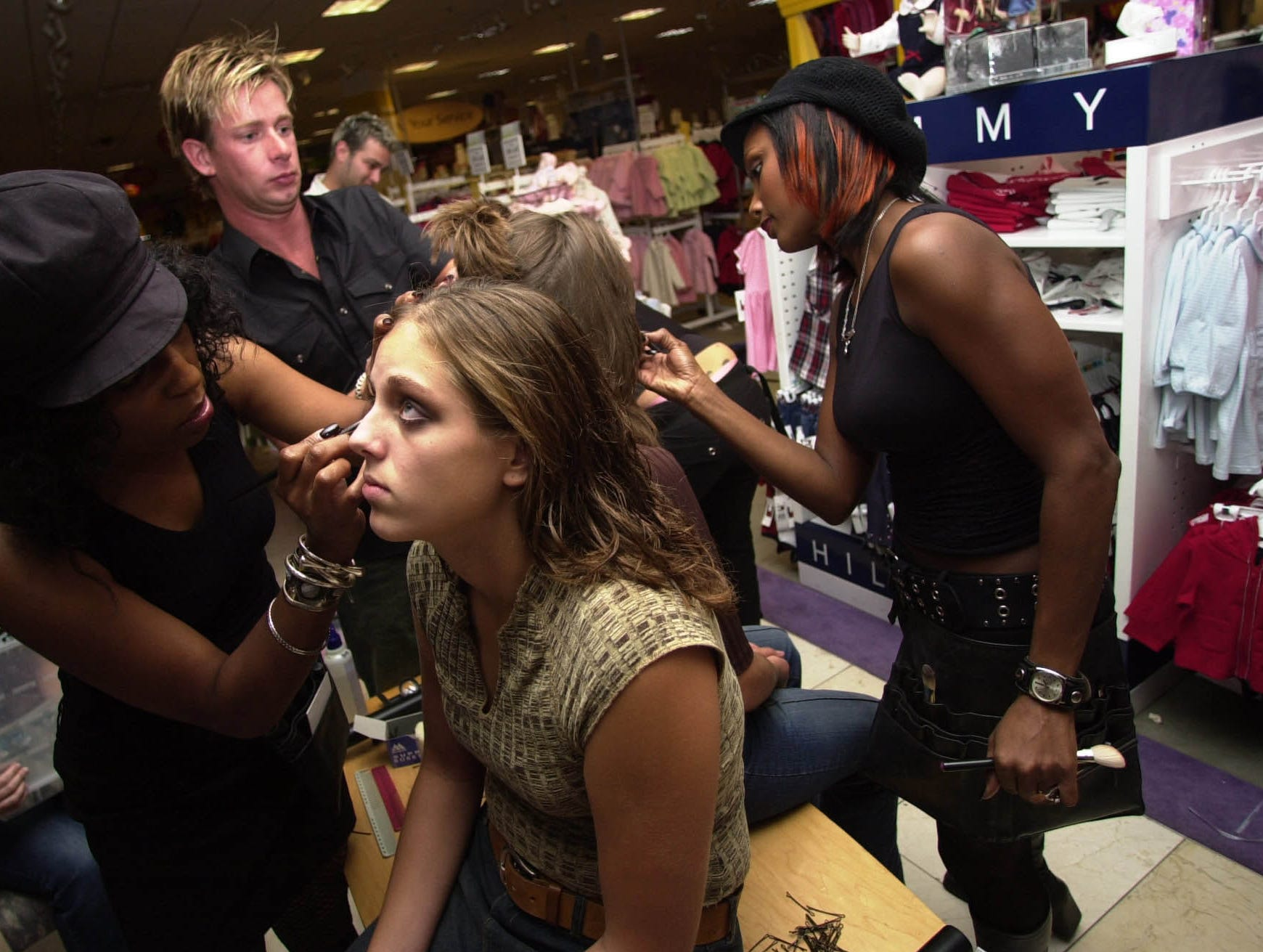 Christa Moser gets a make-over in Proffitt's department store at West Town Mall during the BUrself fashion show. 2003