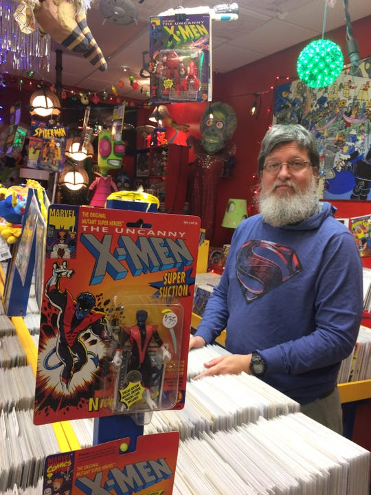 Randy Cross' comic book shop has a large inventory and is also filled with his original artwork.
