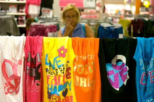 T-shirts are showcased along the aisle at the J.C. Penney in West Town Mall on Aug. 4, 2010. Retail outlets are gearing up for the Tennessee sales tax weekend holiday, which starts July 26.