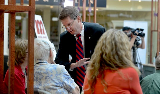 Knox County Mayor Tim Burchett talks to volunteers manning phones in a common area near JC Penny's.  Burchett and his staff organized a 12-hour telethon inside West Town Mall Monday, Jul. 29, 2013 to raise funds for the Mobile Meals program.  By 9 a.m. they had raised over $34,000 for the program.  (MICHAEL PATRICK/NEWS SENTINEL)