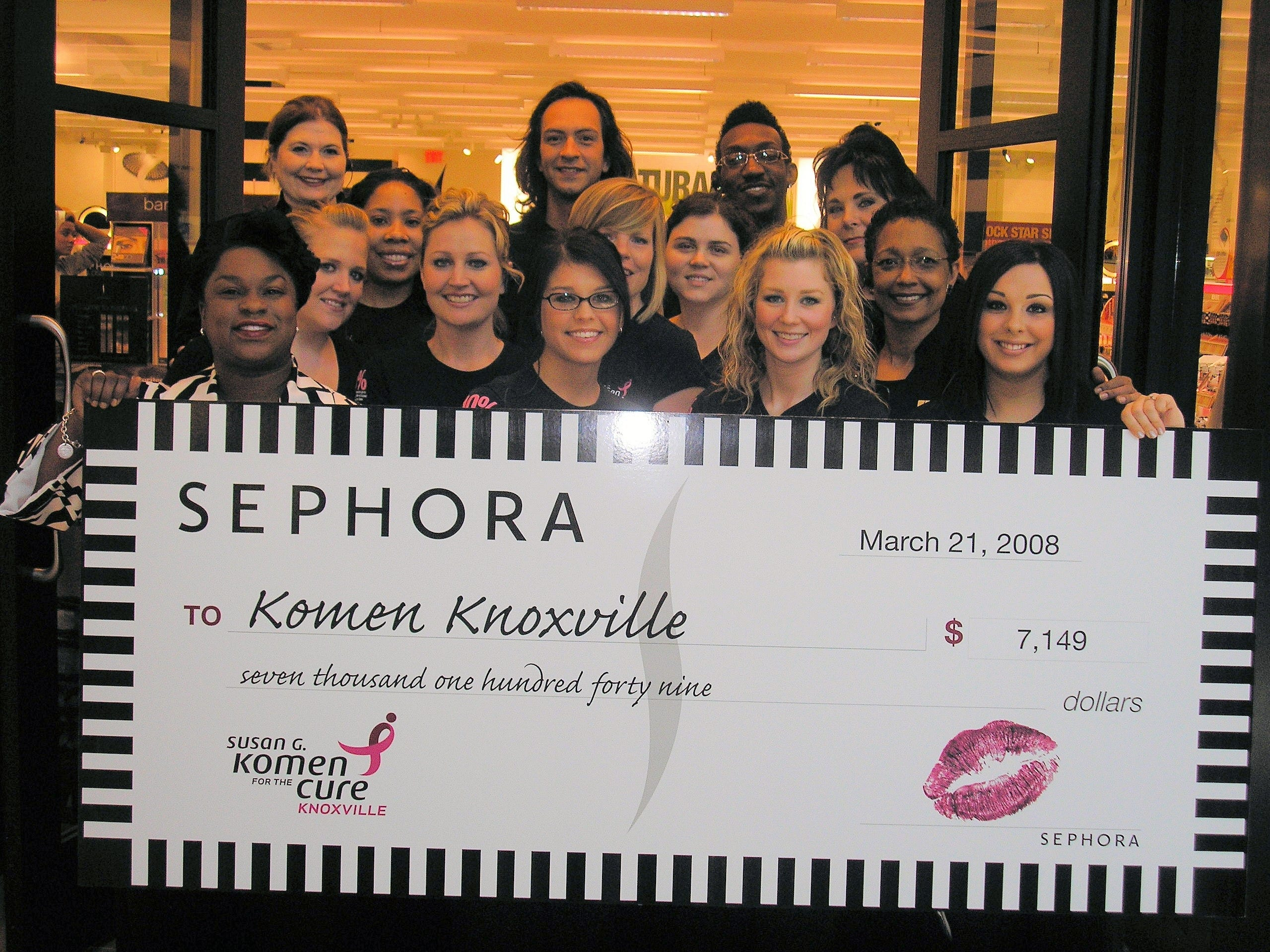 Cecilia Whittington of the Knoxville Affiliate of Susan G. Komen for the Cure, front row, far left, accepts a check from Sephora associates including Joy Wellman, store director of the West Town Mall location, top left. Beauty retailer Sephora recently donated $7,149 from its grand opening sales on Feb. 29 to the Knoxville Affiliate of Susan G. Komen for the Cure, which has invested more than $3 million dollars in local breast health and breast cancer awareness projects in Knoxville and 15 surrounding counties since 1997.