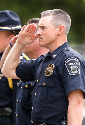 In this file photo, West Lafayette Deputy Police Chief Troy Harris, salutes during Police Officer Memorial Day services in May 2018.