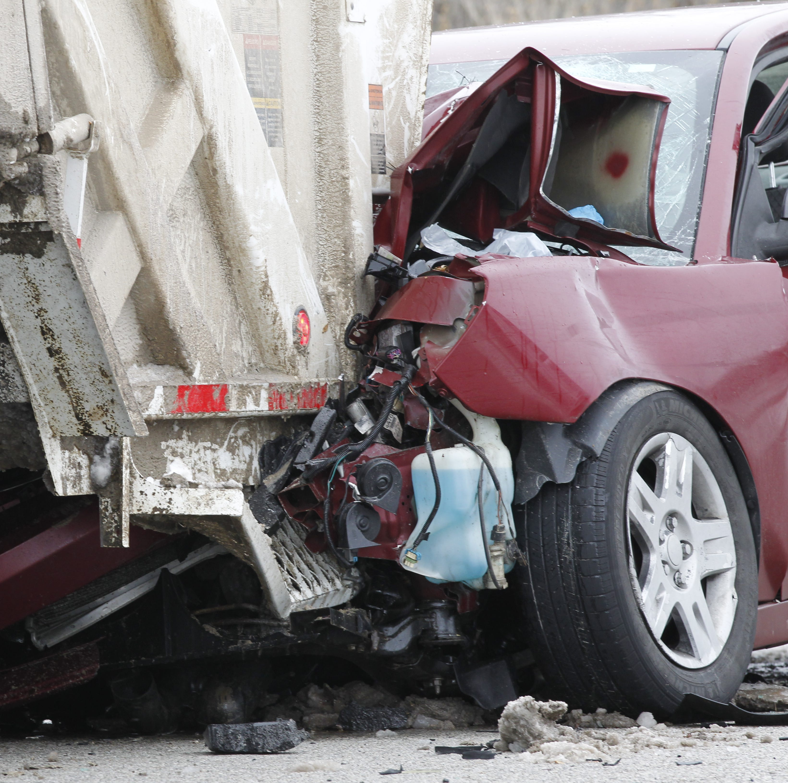 Driver dies after colliding with trash truck