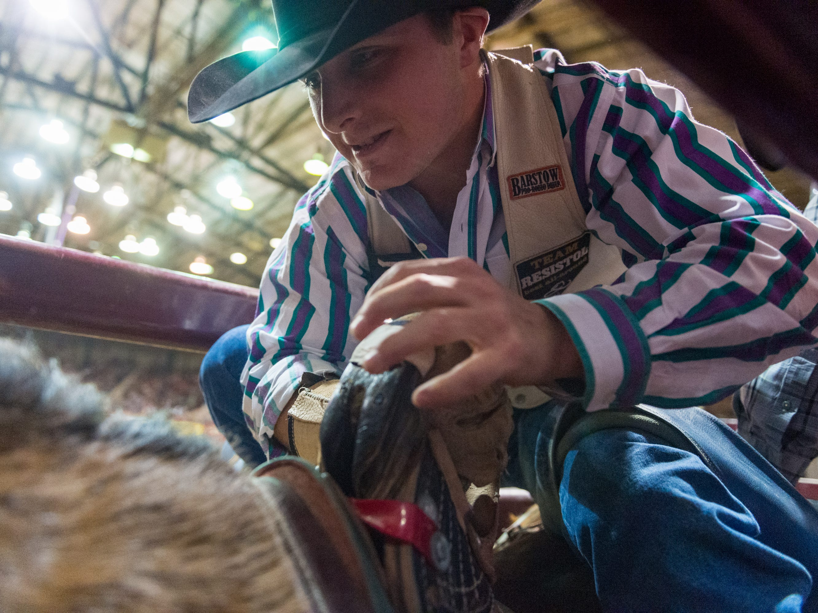 Bareback rider Tanner Phipps knods for the gate at the Mid Winter Fair and Pro Rodeo at Blackham Coliseum. Saturday, Jan. 12, 2019.