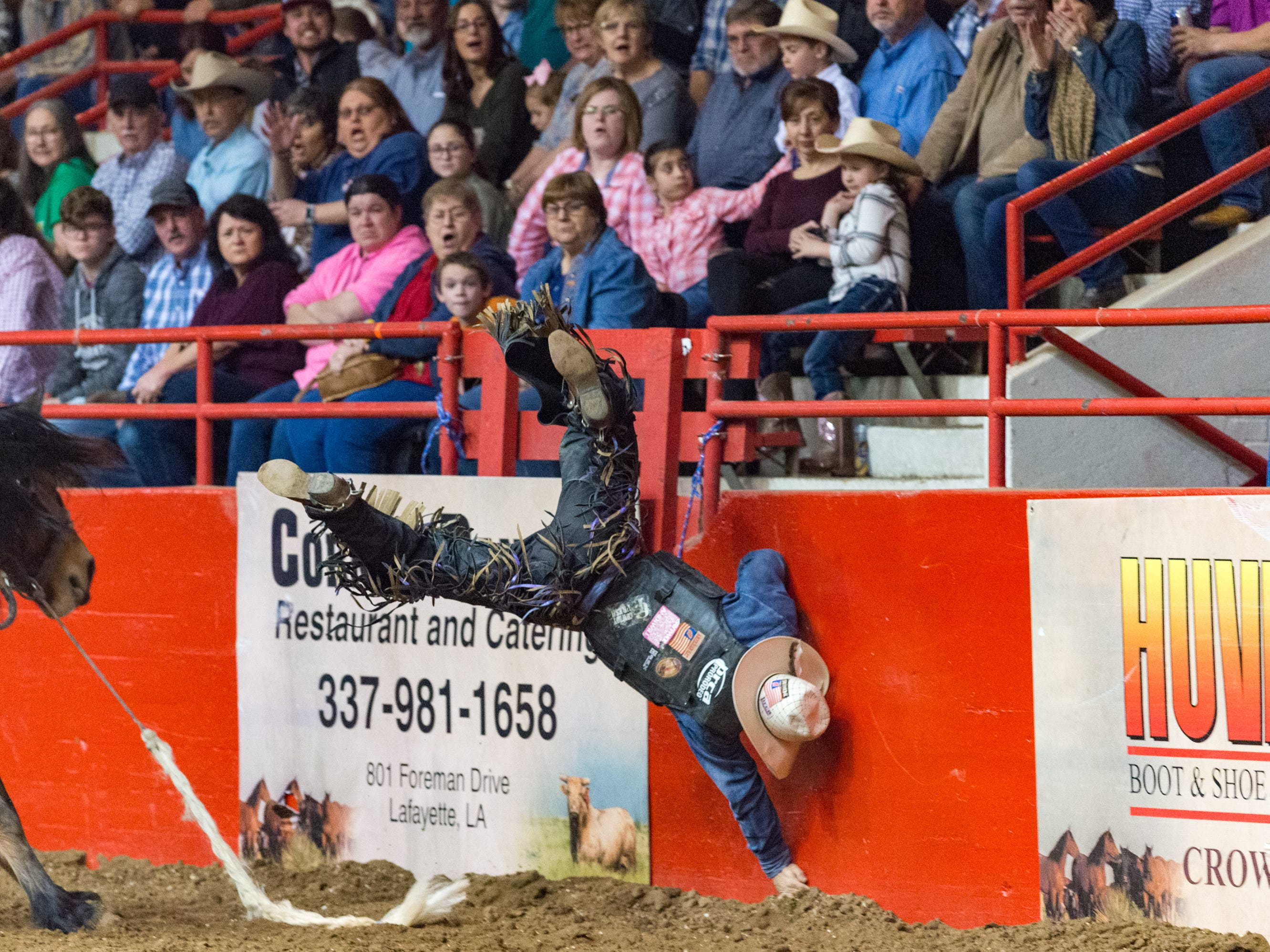 Jake Barnes  thrown from bronc during the Mid Winter Fair and Pro Rodeo at Blackham Coliseum. Saturday, Jan. 12, 2019.