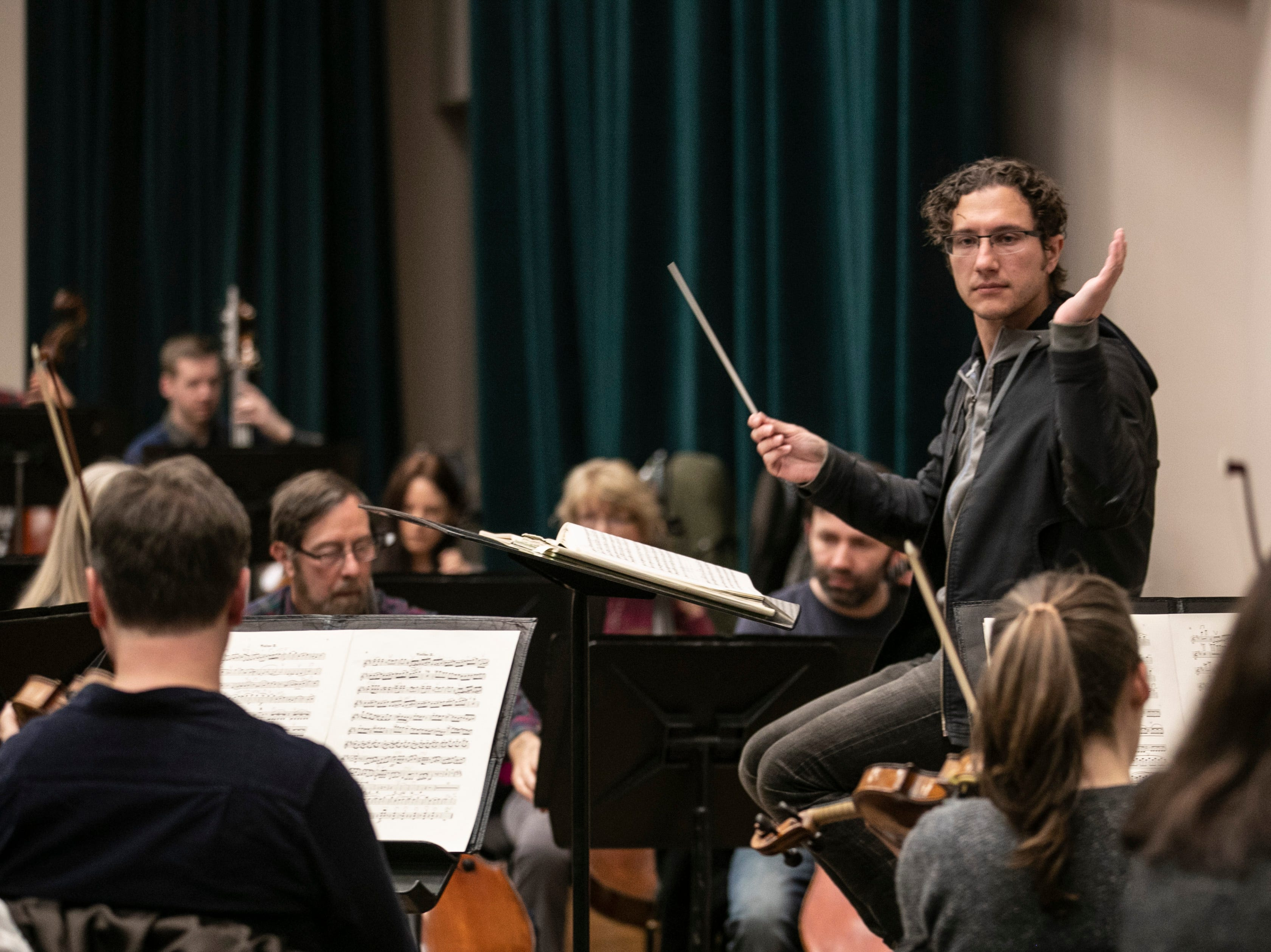 Conductor Teddy Abrams conducts the Louisville Orchestra during a recent practice for the upcoming show, Star Wars: A New Hope in Concert. The film will be shown at the Kentucky Center as the orchestra plays the score live, led by conductor Keitaro Harada.