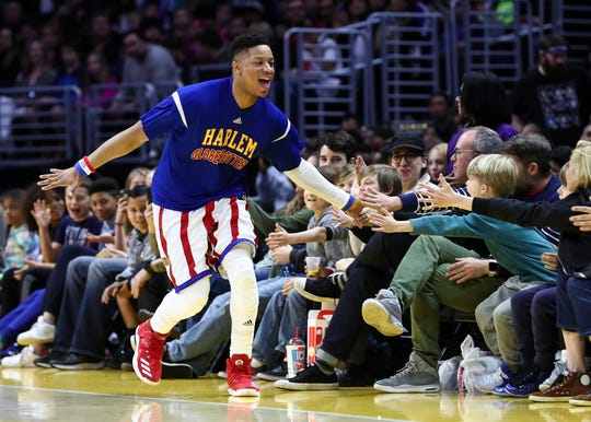 Harlem Globetrotter Jet Rivers interacts with fans during the 2017 Tour.
