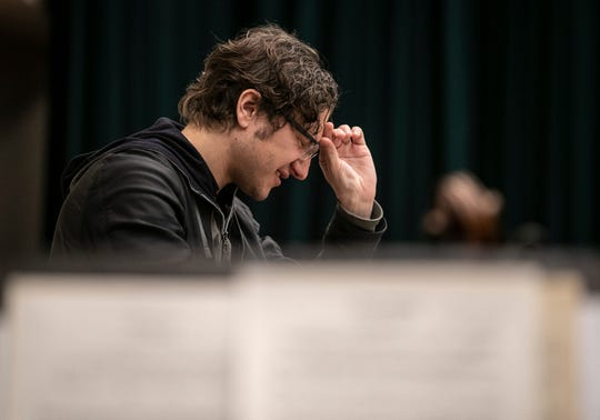 Conductor Teddy Abrams pauses while working with the Louisville Orchestra during a recent rehearsal for the upcoming show, Star Wars: A New Hope in Concert. The film will be shown at the Kentucky Center as the orchestra plays the score live.