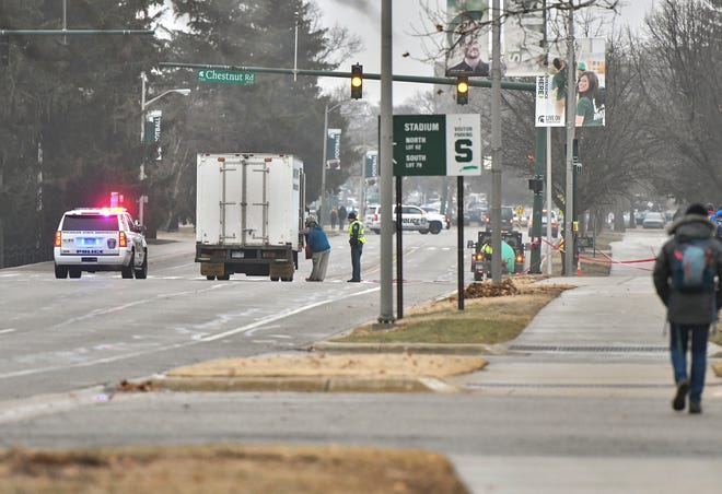 Michigan State University Police and a hazardous waste cleanup team at the scene of a crash Tuesday morning, Jan. 15, 2019, near Chestnut Rd. and West Shaw Lane near Spartan Stadium.