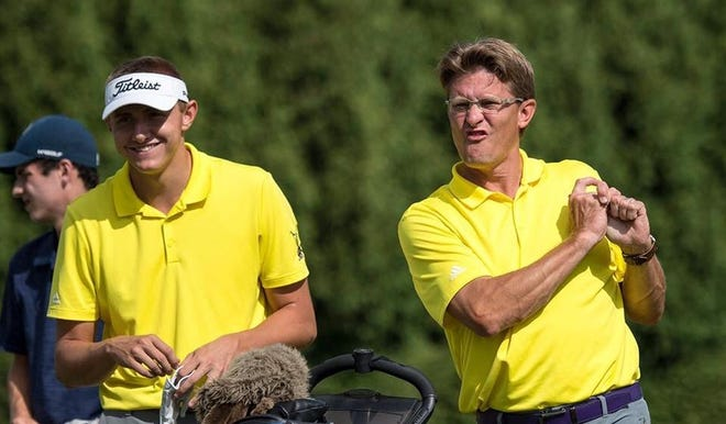 Lexington golfer Nick Stehle and coach Greg Smith share a light-hearted moment on the course this past season.