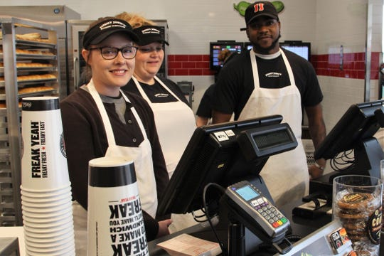 Jimmy John's employees Brittney Greenawalt, Stephanie Swigert and Thomas Moore stand behind the counter during the Marion location's grand opening on Tuesday. They said there had been a steady stream of customers since the doors opened at 10 a.m.