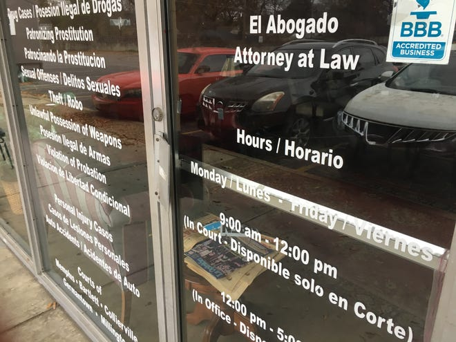 A look at the shuttered storefront of the Abogados law firm on Summer Avenue.