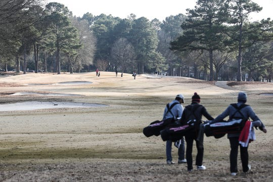 Golfers make their way up the fairway while playing at the Germantown Country Club in January 2019. The club closed for good the next month.