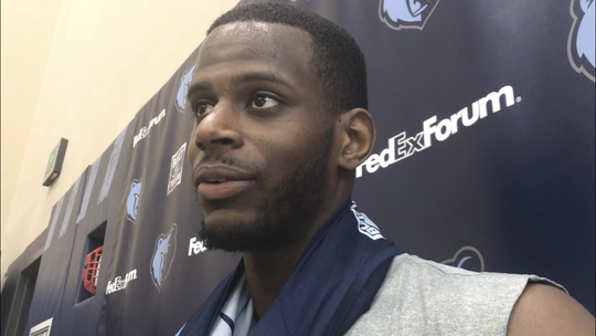 New Grizzlies two-way player Julian Washburn talks with the media after his first practice with the team at FedExForum on Jan. 15, 2019.