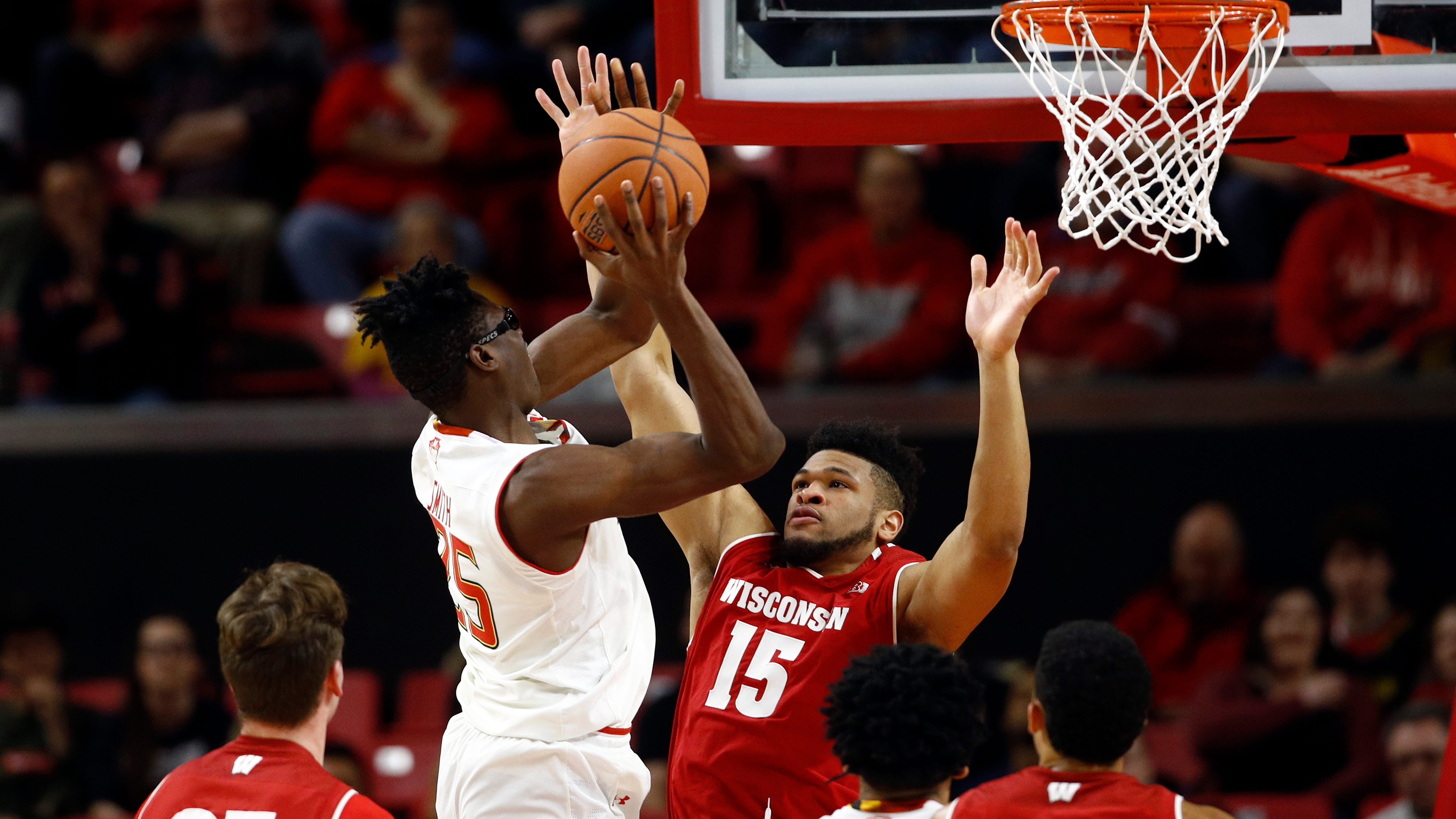Maryland forward Jalen Smith, left, shoots over Wisconsin forward Charles Thomas IV in the first half of an NCAA college basketball game, Monday, Jan. 14, 2019, in College Park, Md. (AP Photo/Patrick Semansky) ORG XMIT: MDPS102