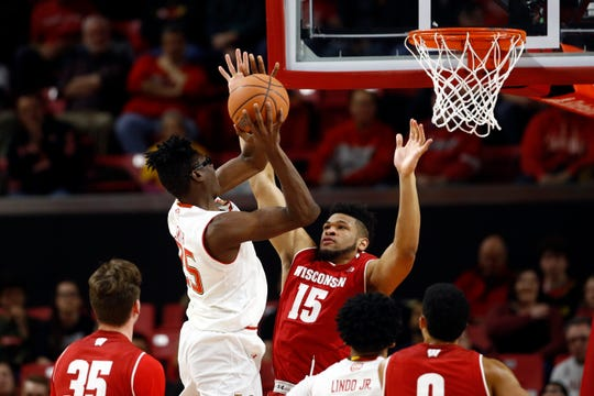 Maryland forward Jalen Smith shoots over Wisconsin forward Charles Thomas IV on Monday night.