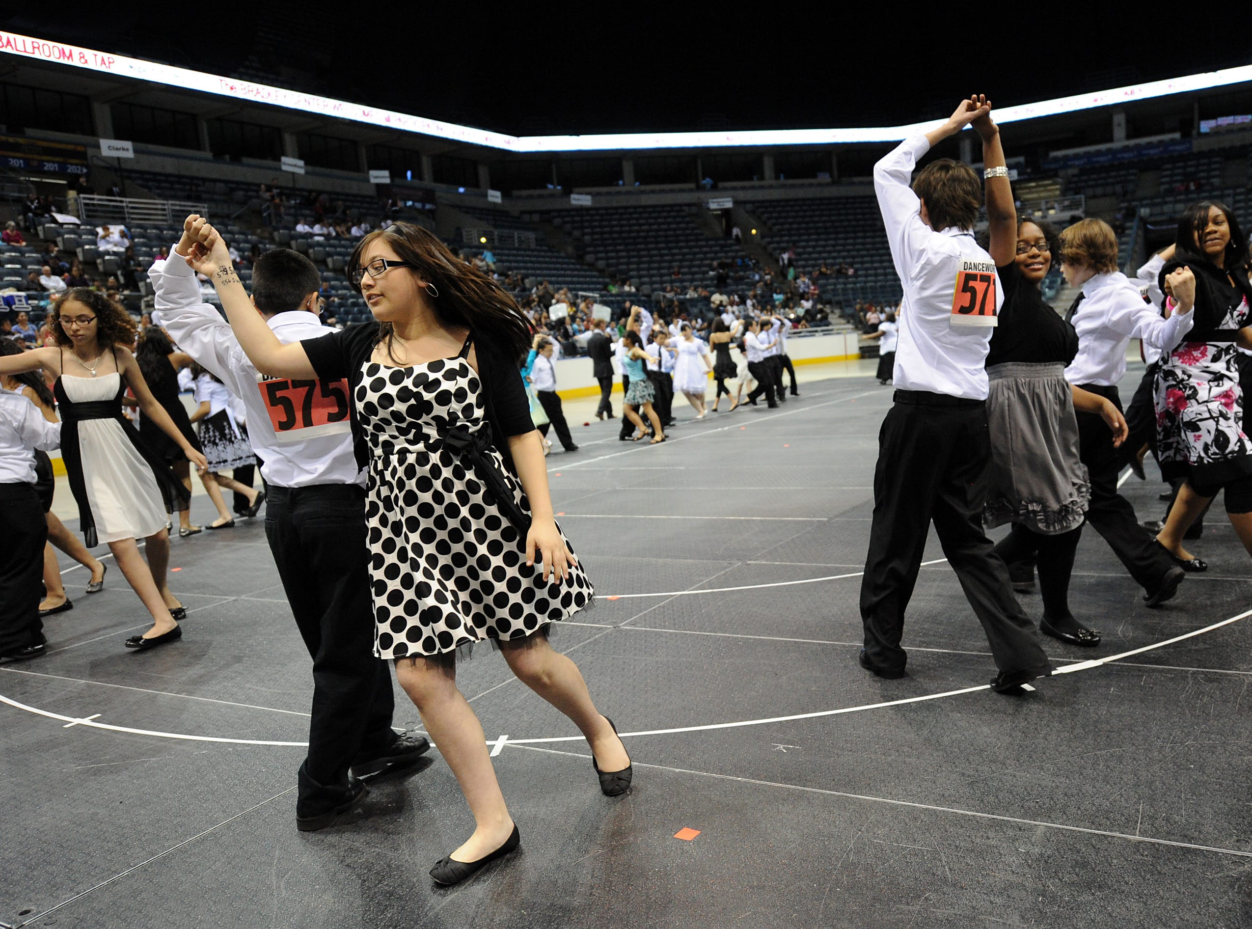 2010: Danna Casillas (left) and her partner, Brandon Reyes, both sixth-graders at Greenfield Bilingual School, Milwaukee, dance salsa during the annual Mad Hot Ballroom and Tap Competition at the Bradley Center.