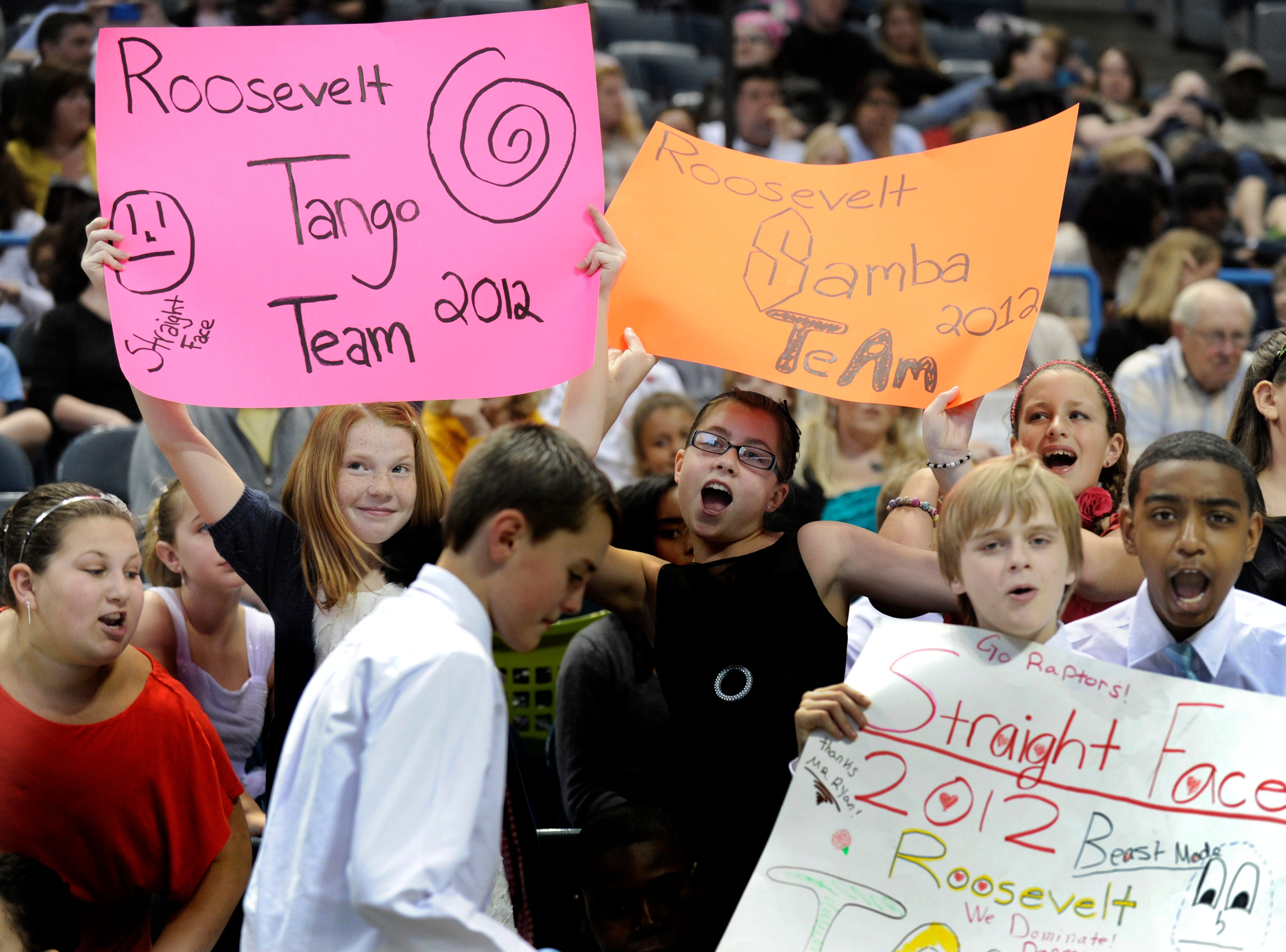 2012: Holding signs and cheering their Roosevelt Elementary School team are (from left) Claire Purcell, Abigail Schermerhorn, Jake Wills and Shamar McLennon during the Danceworks Mad Hot Ballroom and Tap competition at the Bradley Center.