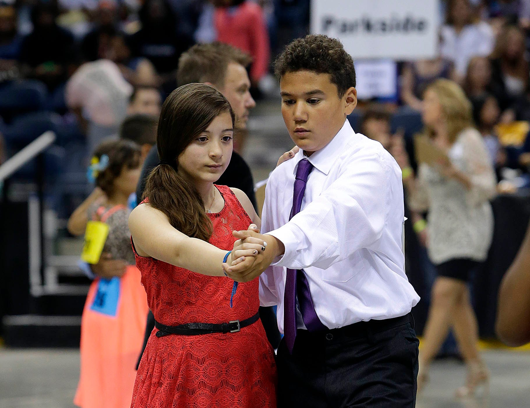 2015: Sophia Lopez and Eamon Bridges, from MPS Hartford University School, join about 2,000 local students from 45 area schools in the annual Mad Hot Ballroom and Tap competition at the Bradley Center.