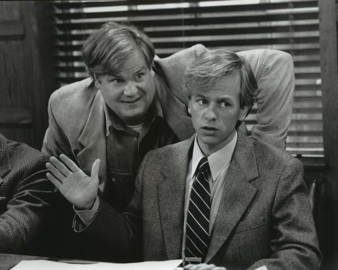 "Tommy Callahan (Chris Farley, left) sets out to hit the road with his late father's assistant (David Spade) to save the family business in ""Tommy Boy."" The late Farley's 1997 Harley-Davidson motorcycle was recently bought at auction by Spade this month."