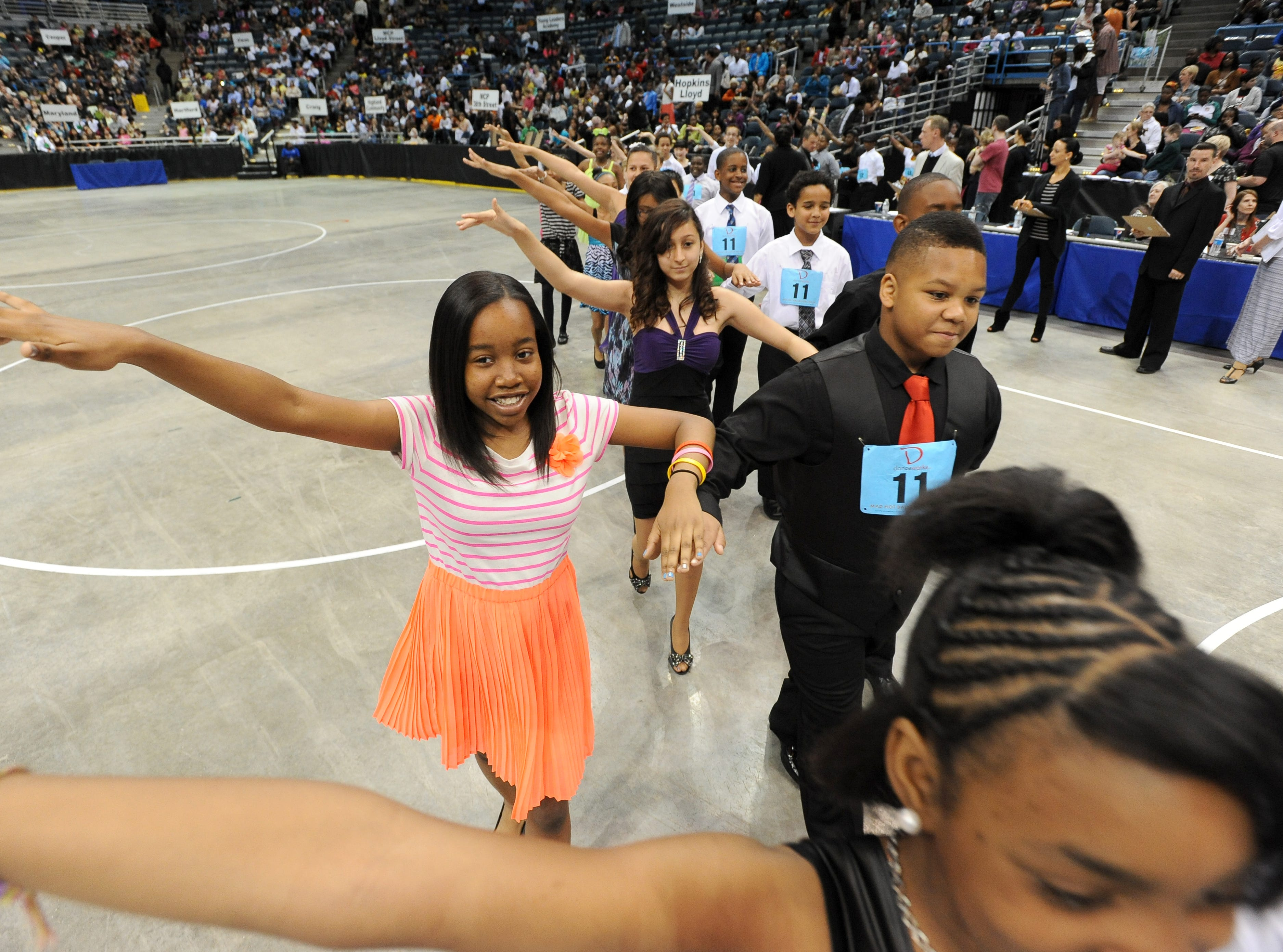 2013: Nearly 2,200 local students from 43 area schools perform and compete in the Mad Hot Ballroom show at the Bradley Center.