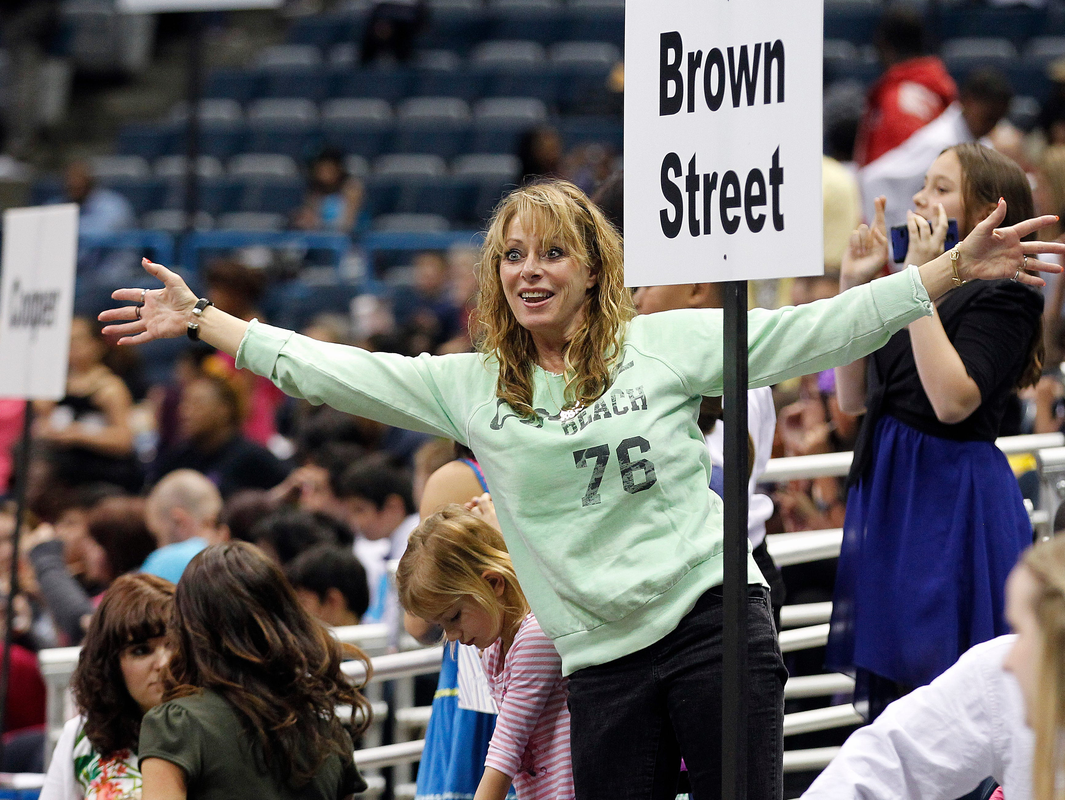 2014: Diane Michaels, of Arizona, roots for students from Trowbridge Street School dance during the annual Mad Hot Ballroom and Tap competition at the BMO Harris Bradley Center.