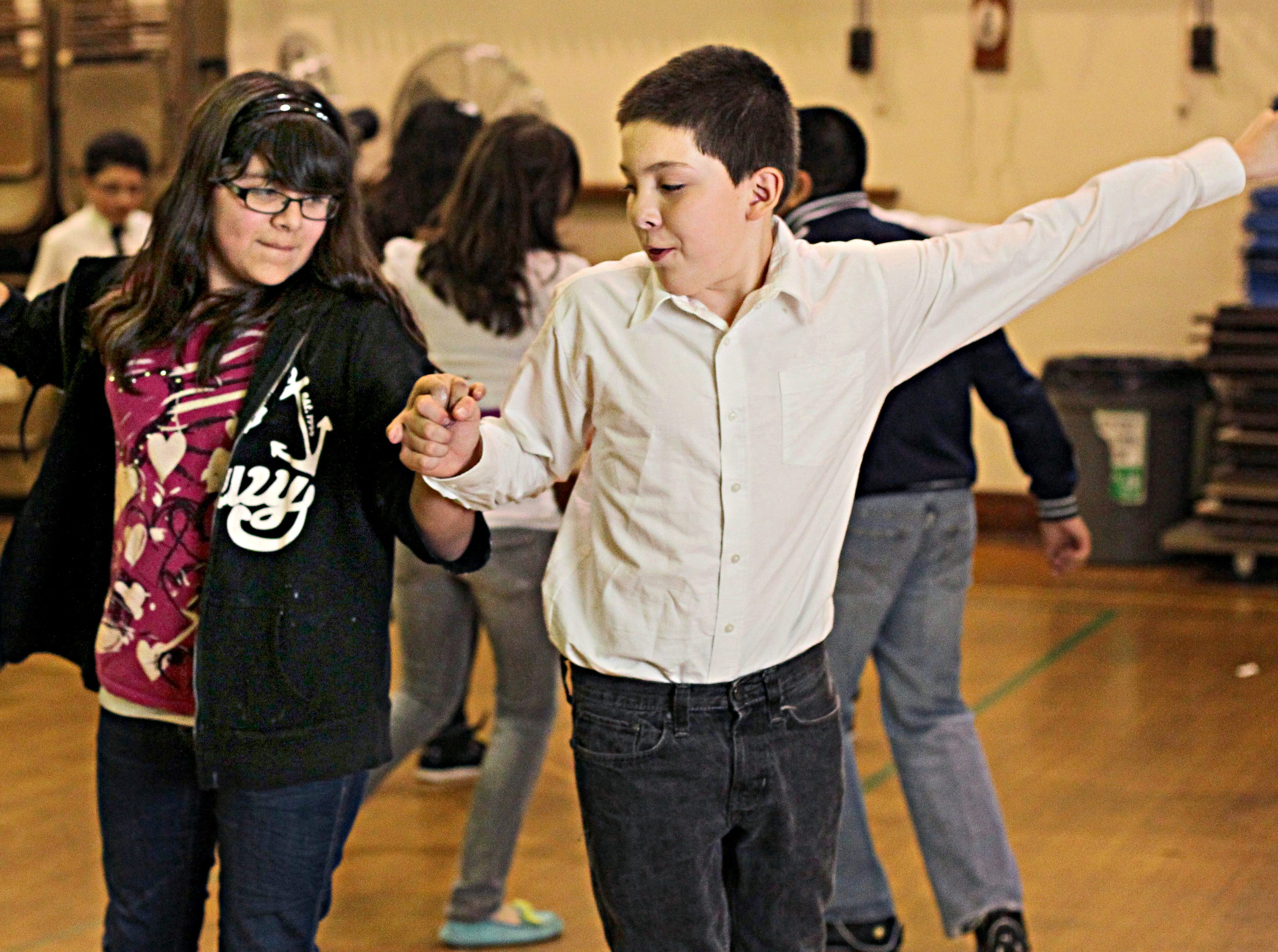 2011: At Vieau School, Isabella Hernandez dances with Joseluis Garza.