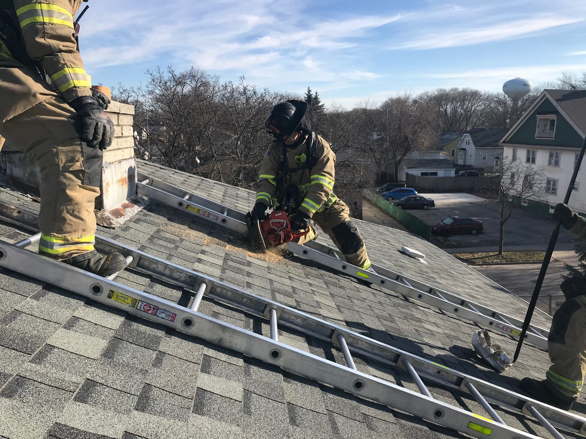 High above the ground, West Allis firefighters hone their techniques on a vacant apartment building. The structure is soon to be razed to provide room for the neighboring Chr. Hansen company to expand.