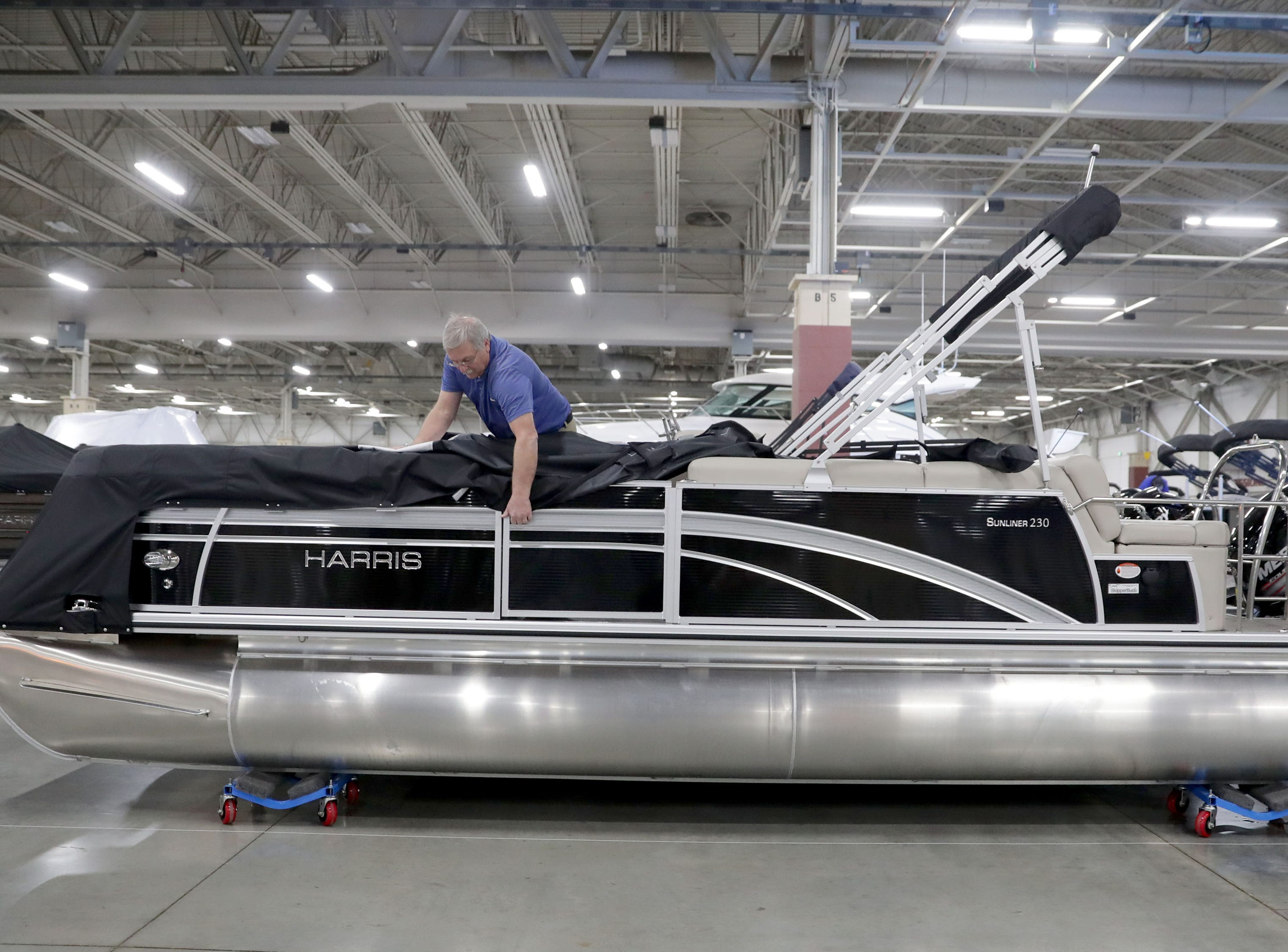 Gary Krivos, with Skipper Buds of Pewaukee, sets up a  Harris pontoon boat.