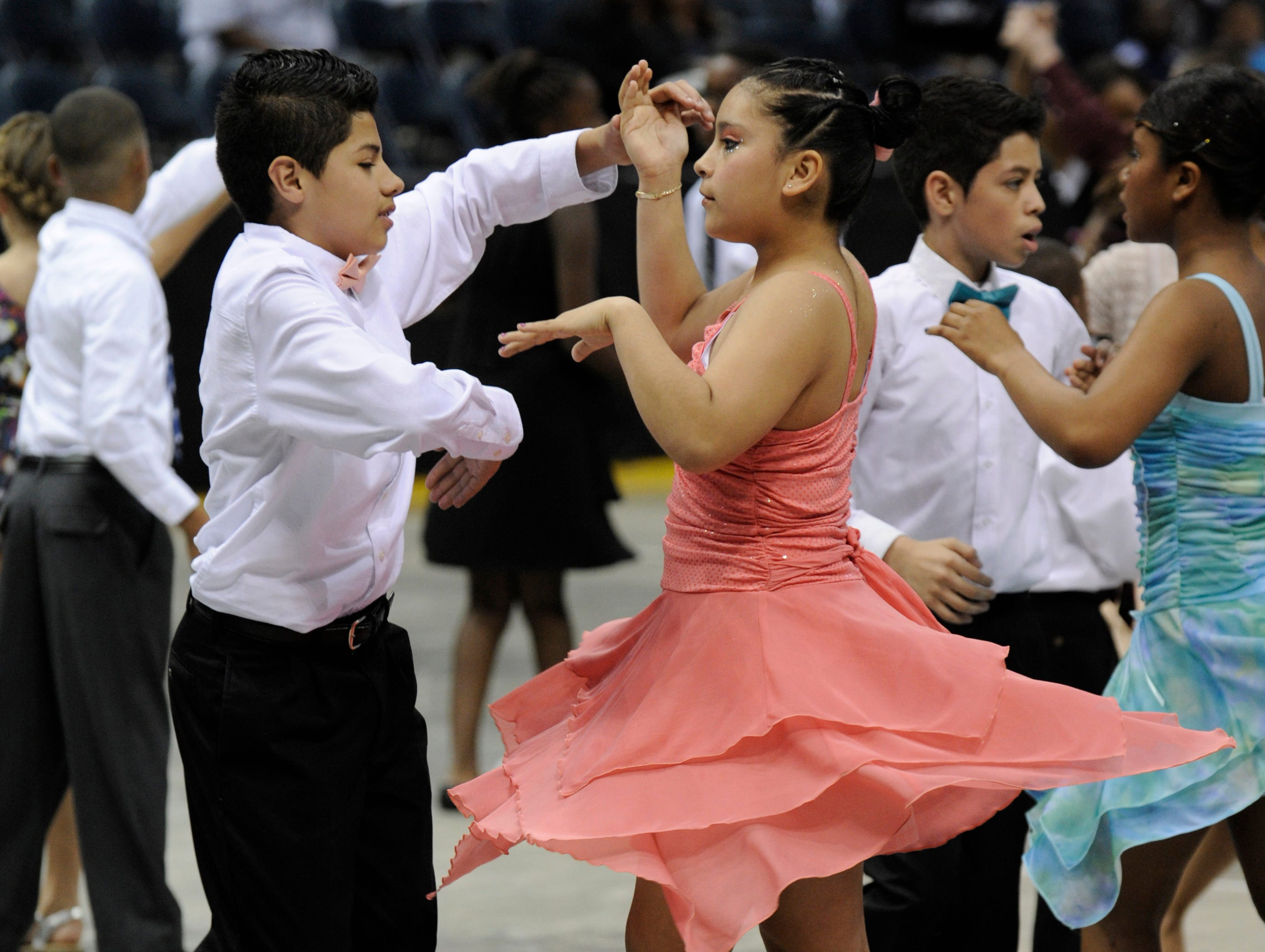 2012: Antonio Rodriguez and Anahi Ortega from Escuela Vieau school dance the samba on the Bradley Center floor during the Danceworks Mad Hot Ballroom and Tap competition.