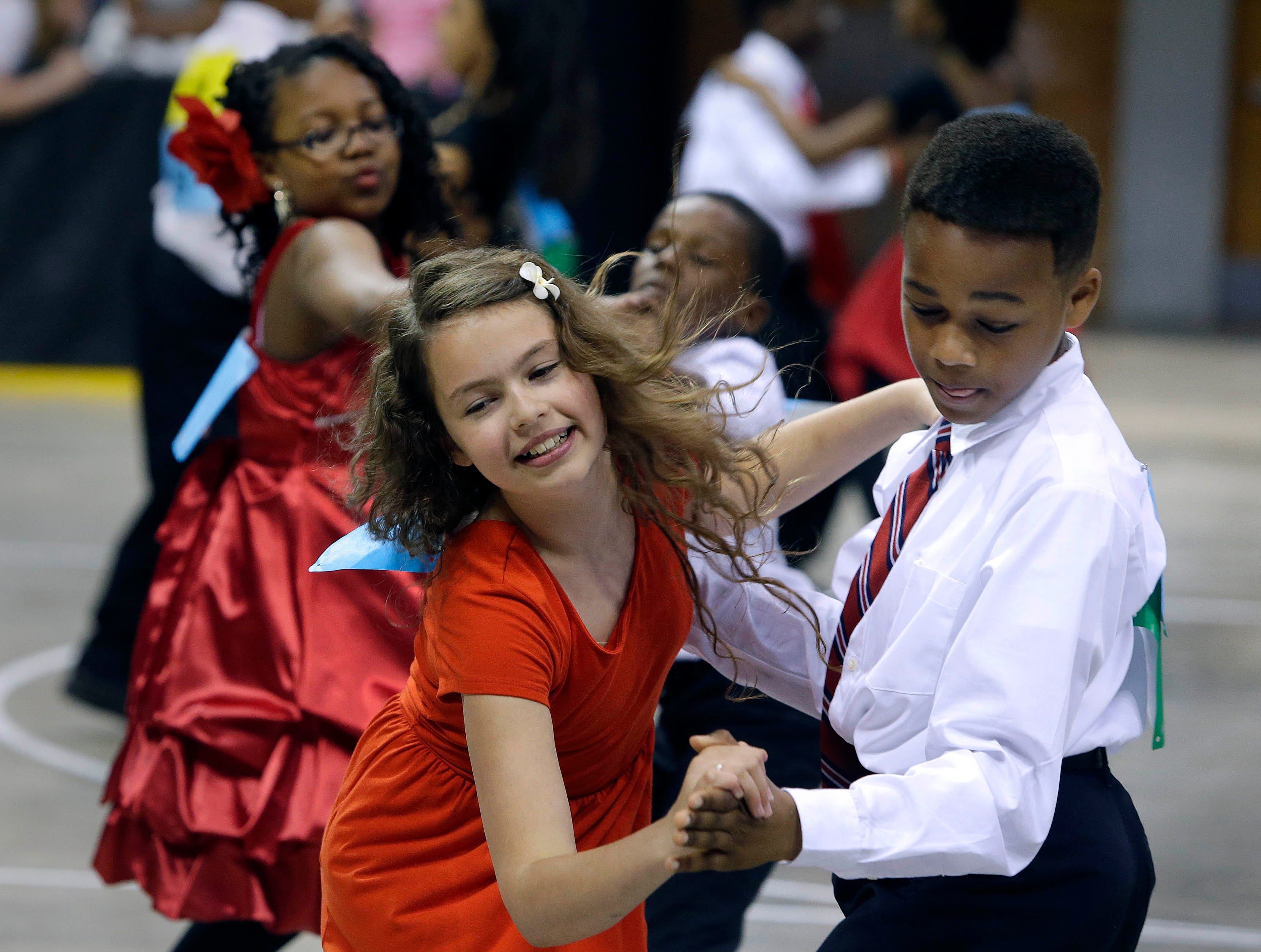 2015: Sophia Seymour and Cliffton Kincaid, 5th graders at the French Immersion School, perform the tango. About 2,000 local students from 45 area schools performed and competed in the annual Mad Hot Ballroom and Tap competition at the Bradley Center.