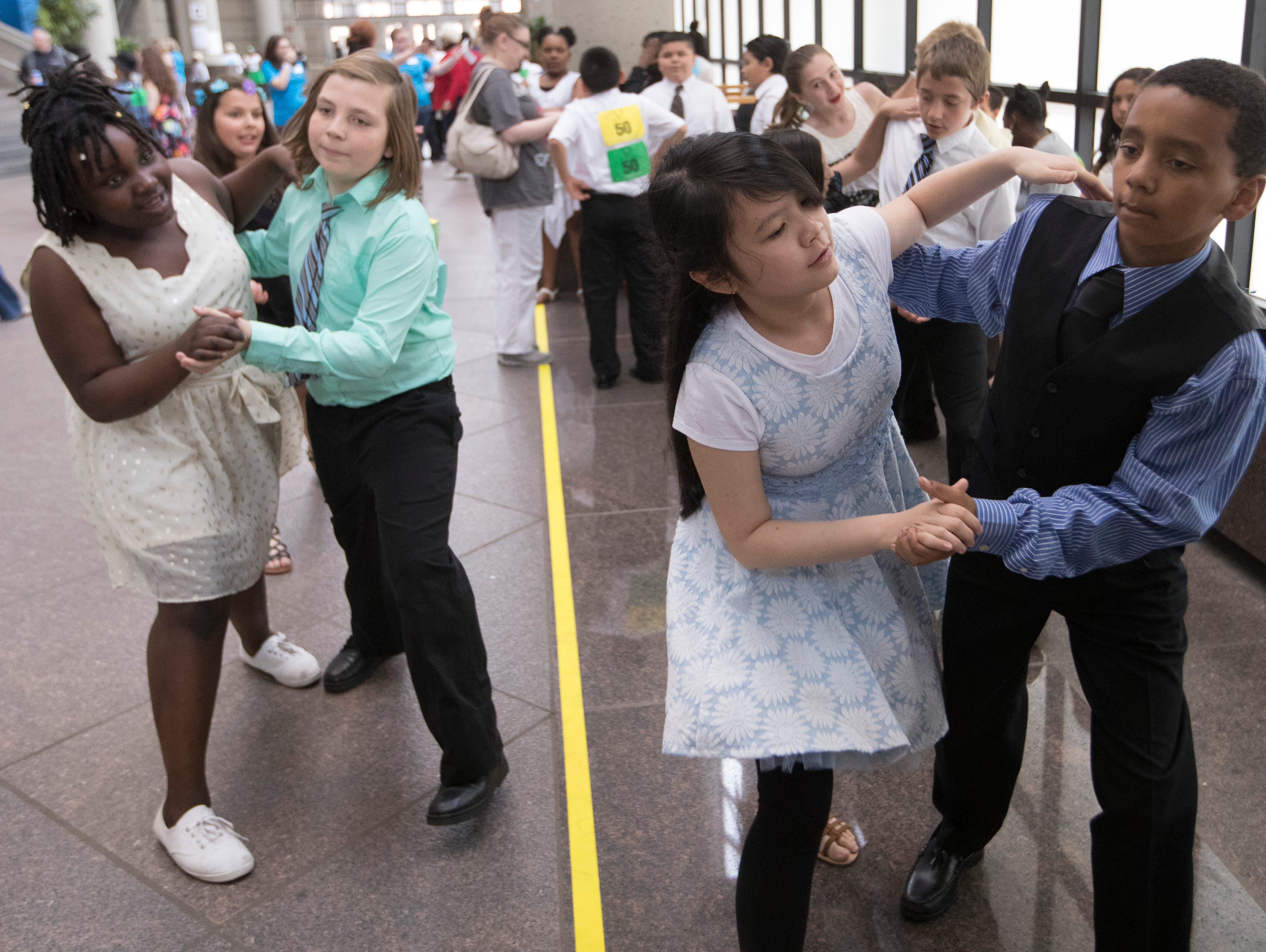 2018: Students from Alcott Elementary School rehearse in the lobby during the 12th annual  Danceworks Mad Hot Ballroom and Tap Competition at the BMO Harris Bradley Center. More than 1,000 5th and 6th grade students from more than 50 Milwaukee area schools competed and showed off the salsa, tango and swing moves they've been working on since February.