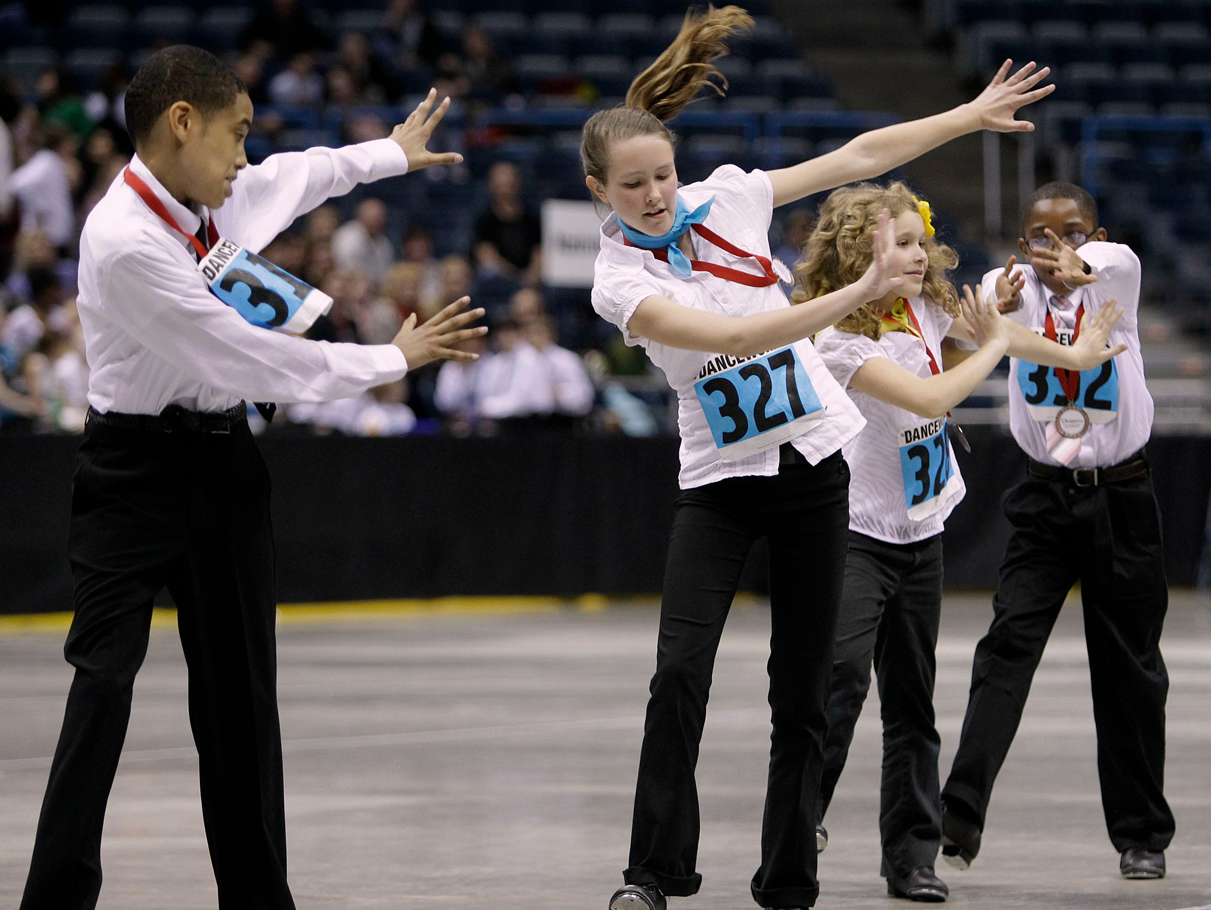 2011: Jordan Bell (left), from Clement Ave. School, and Nikole Weston (2nd from left), from Elm-Dale School,  perform and compete with other students from 39 area schools in the annual Mad Hot Ballroom show at the Bradley Center.