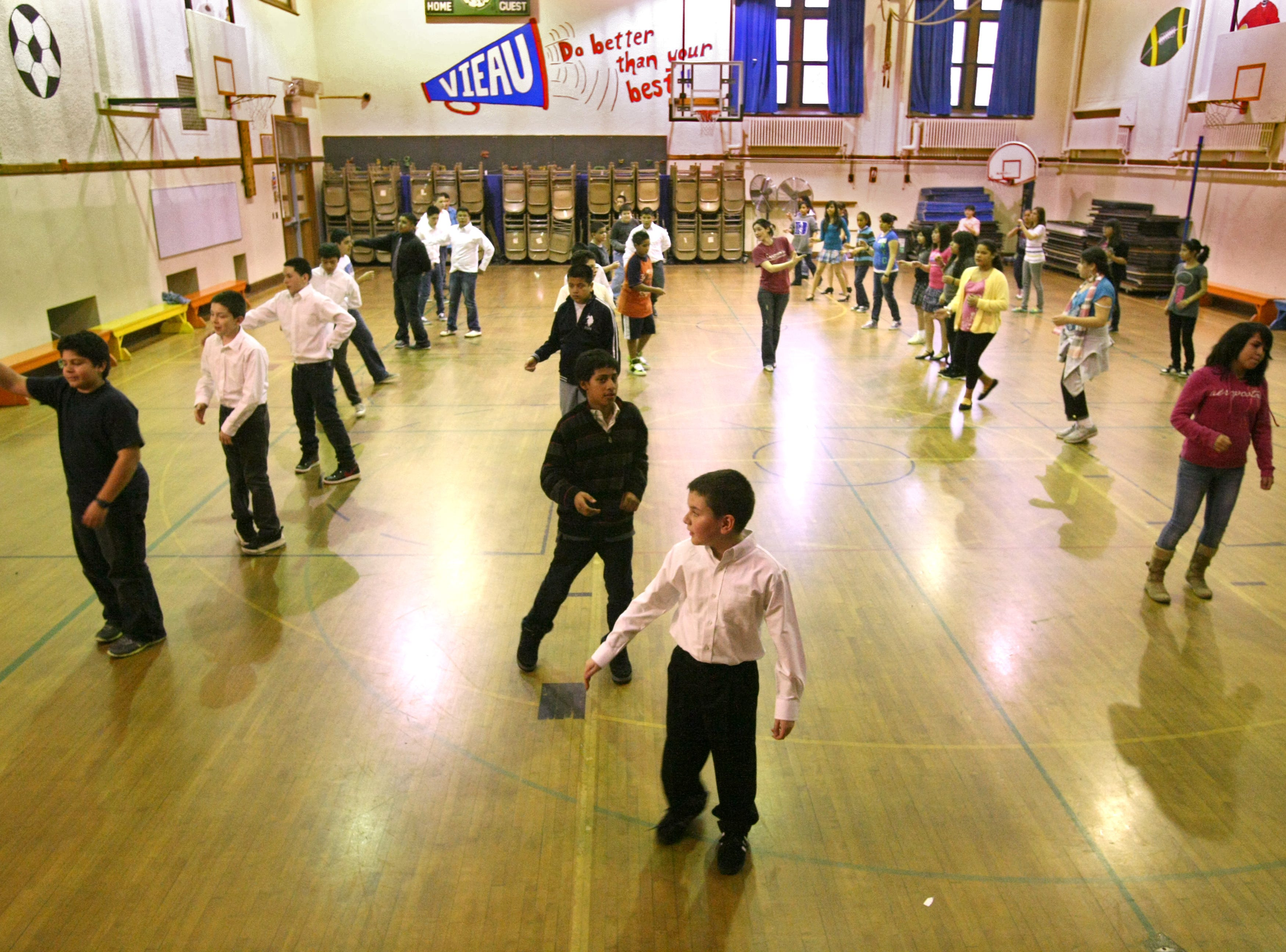 2011: At Milwaukee's Vieau School, 6th grade students practice ballroom dancing in preparation for the Mad Hot Ballroom at the Bradley Center.