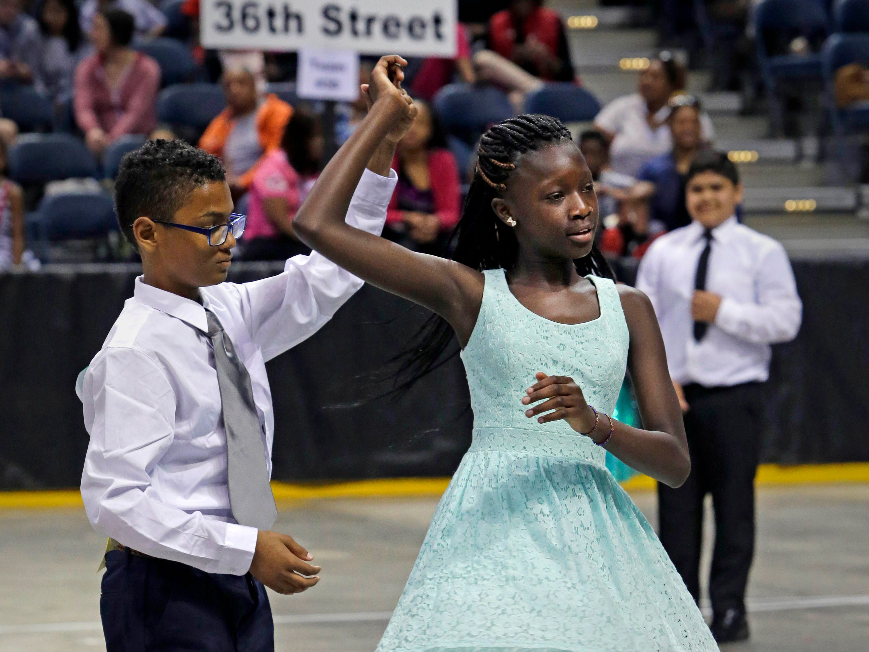2015: Jonathan Crumb and Fanta Kromah, from Luther Burbank Elementary School, join about 2,000 other local students from 45 area schools performed who competed in the annual Mad Hot Ballroom and Tap competition at the Bradley Center.