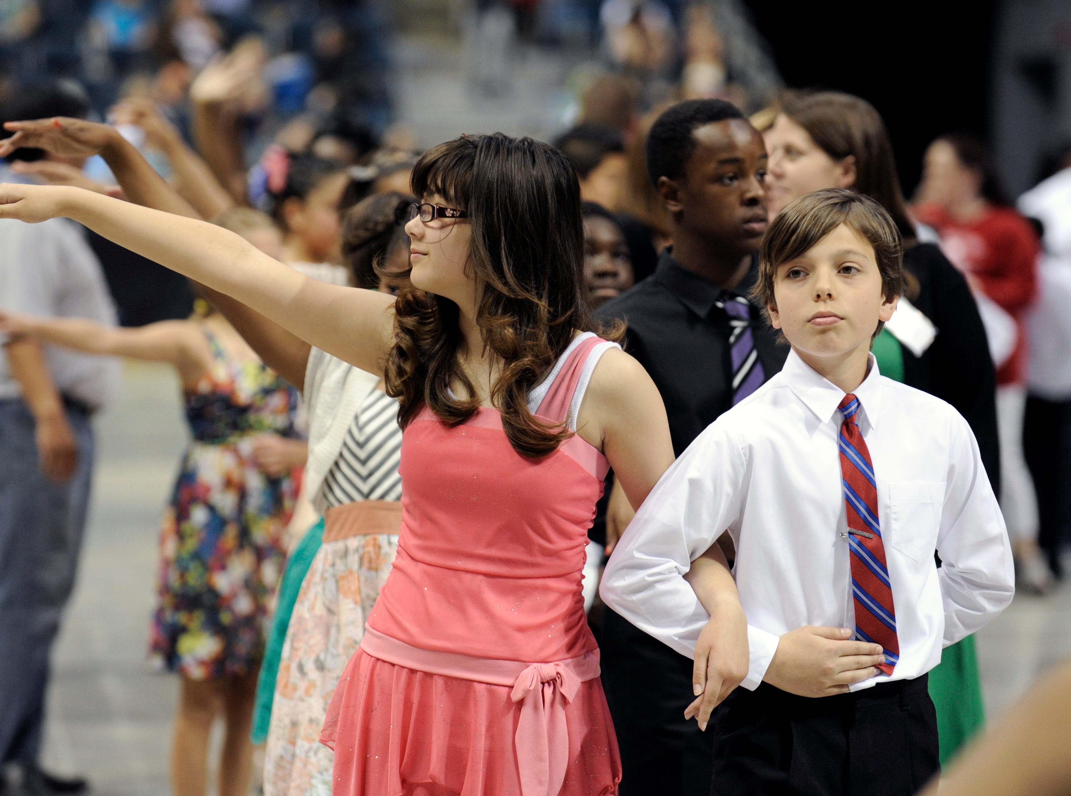 2012: Madison Clausing and Jack Hoeffel from Maryland Avenue School pause before dancing the samba during the Danceworks Mad Hot Ballroom and Tap competition at the Bradley Center.