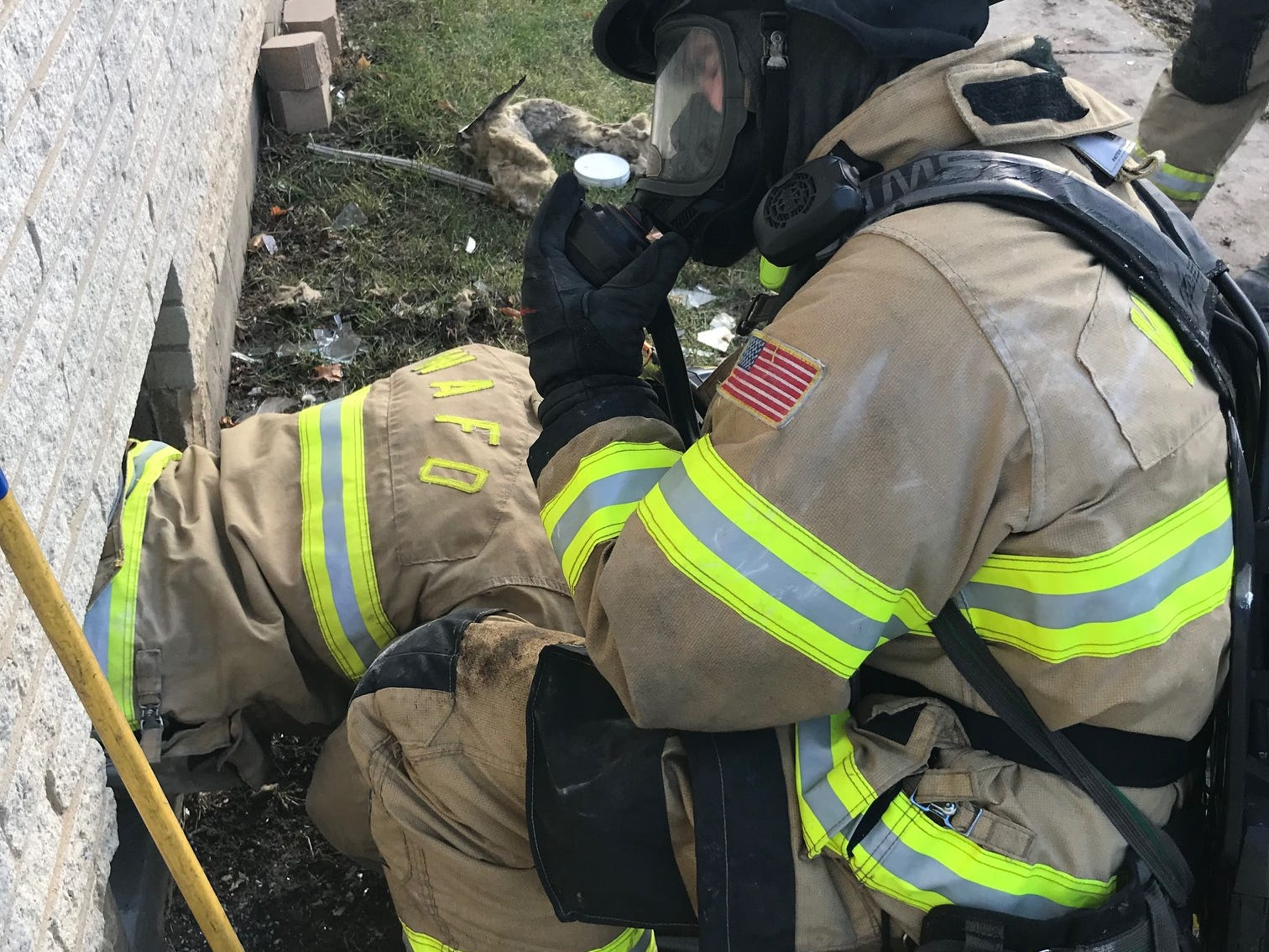 A trapped injured firefighter rescue is practiced, possibly for the first time by West Allis firefighters as they hone their skills at a vacant apartment building. The rescue involves cutting a hole in the wall around a window.