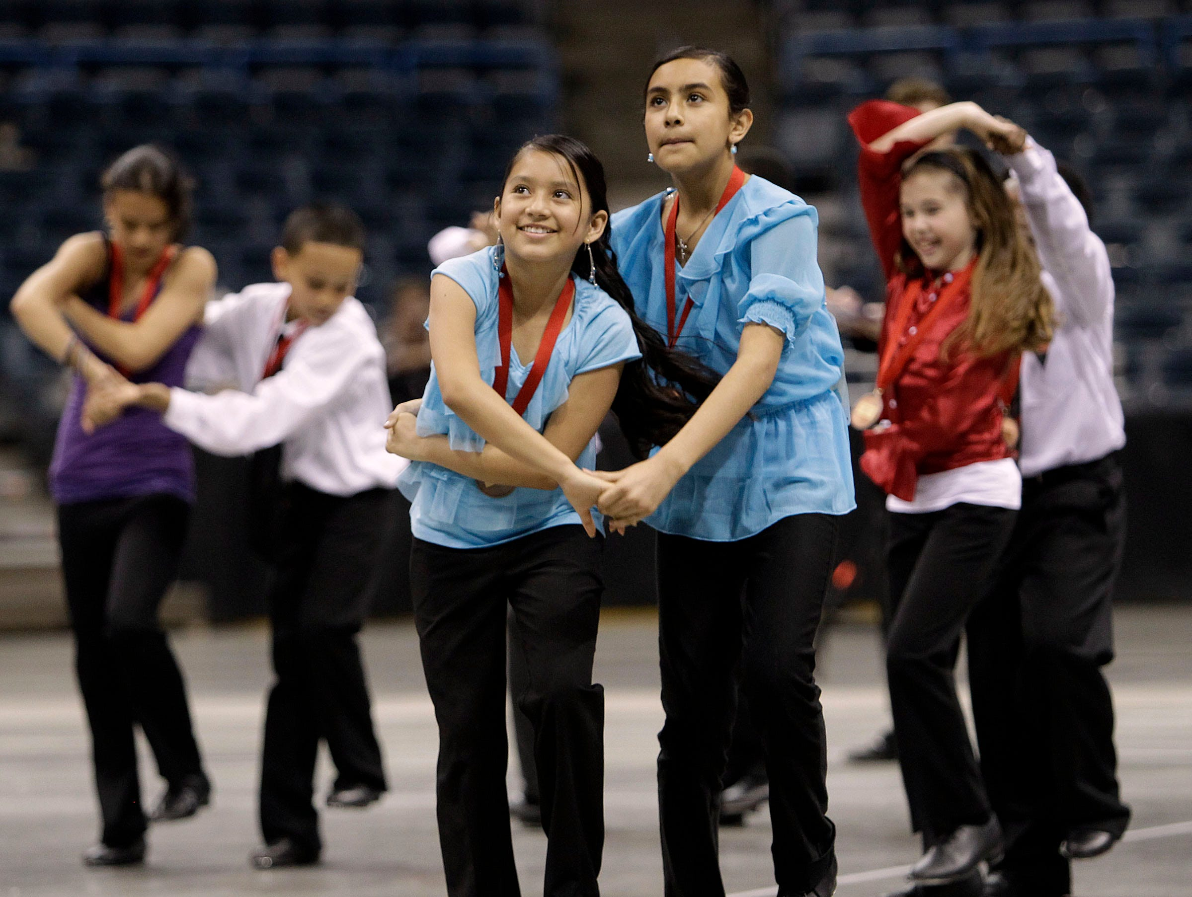 2011: St. Raphael students Nancy Juarez (left) and Jacqueline Sandoval-Hernandez perform and compete in the annual Mad Hot Ballroom show at the Bradley Center.
