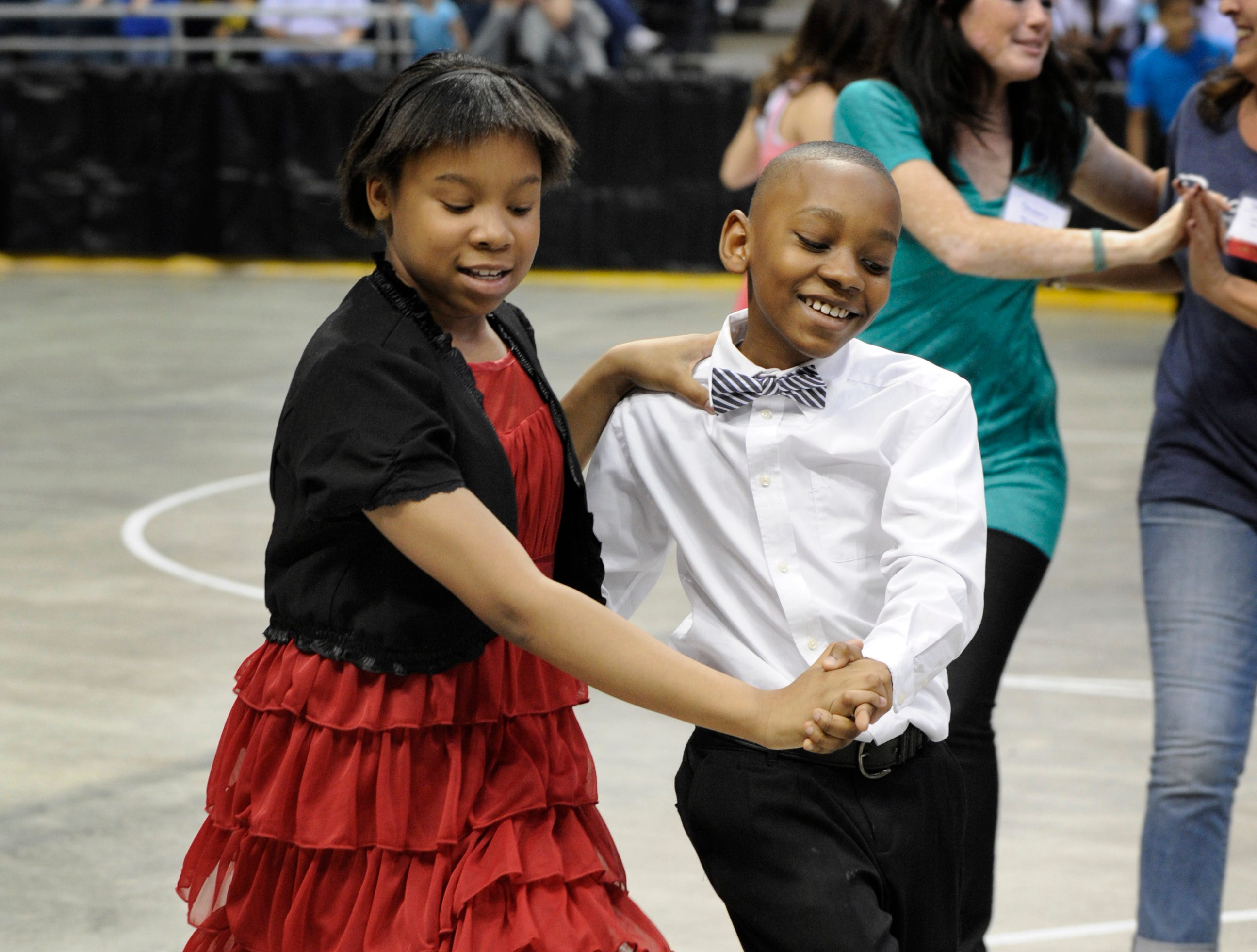 2012: Tiana Smith and Ethan Lee from Milwaukee College Prep School, dance the samba during the Mad Hot Ballroom and Tap competition at the Bradley Center.