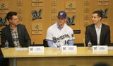The Milwaukee Brewers introduce their new catcher, Yasmani Grandal, at a news conference at Miller Park on Tuesday.
