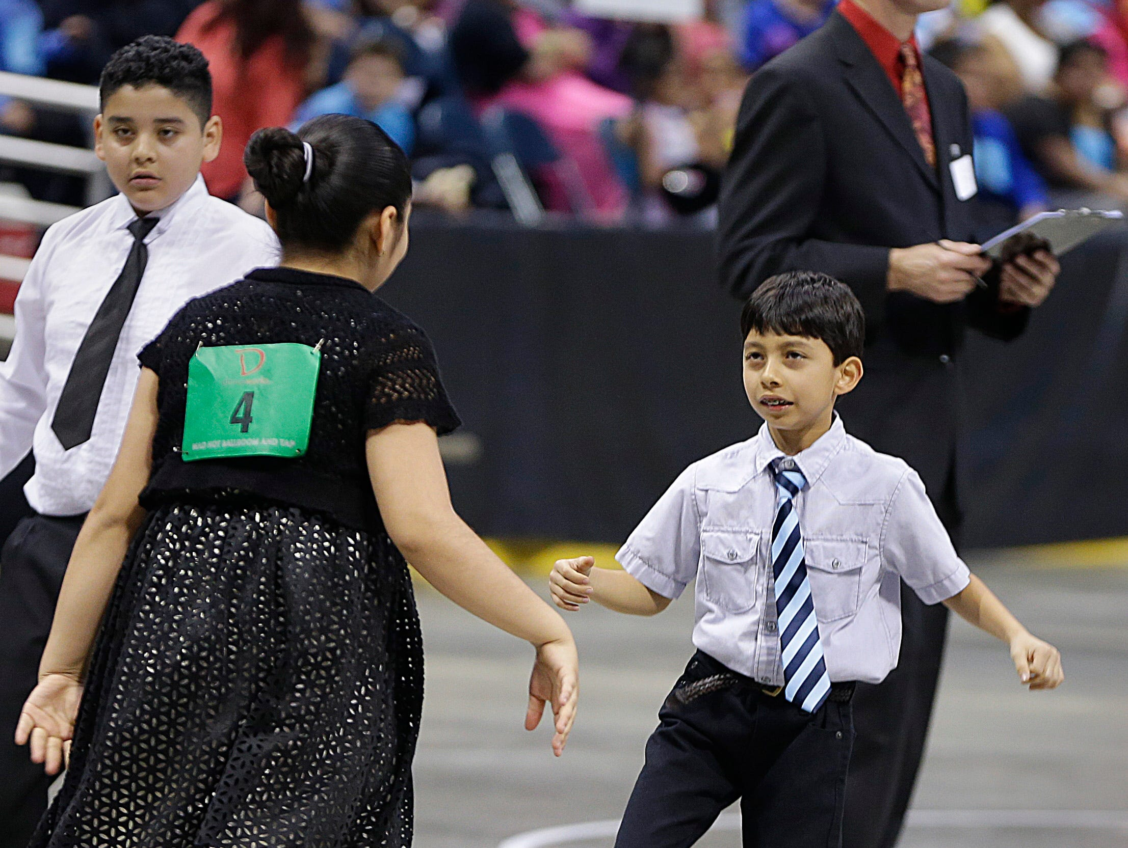 2016: Valeria Portugal, 10, left, and Aztlan Hernandez, 10 from Vieau School, dance in the annual Mad Hot Ballroom and Tap competition at the BMO Harris Bradley Center.