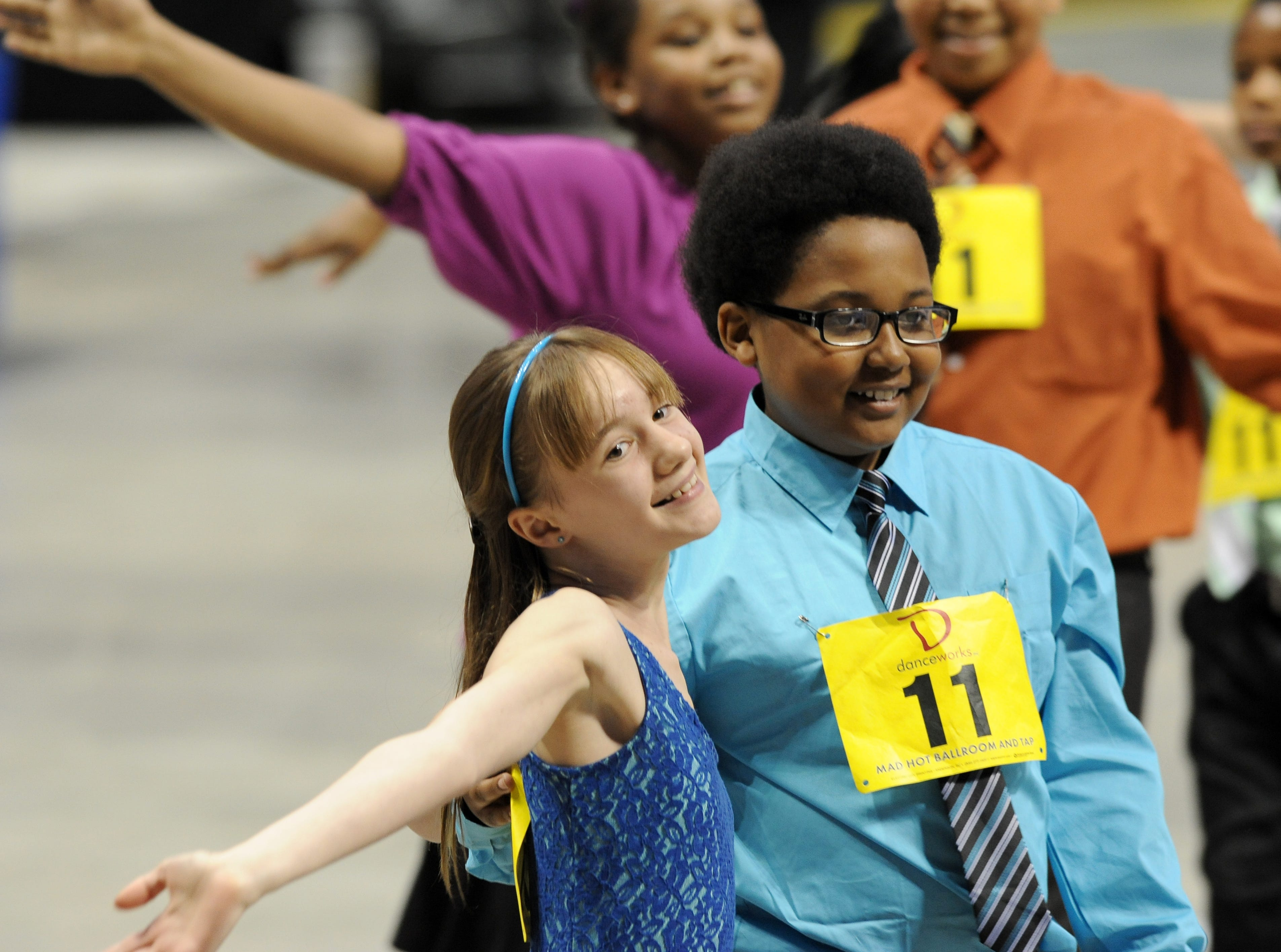 2013: Claire Gerlach, left, and partner Jalen Webster, right dance the foxtrot. Nearly 2,200 local students from 43 area schools perform and compete in the Mad Hot Ballroom show at the Bradley Center.