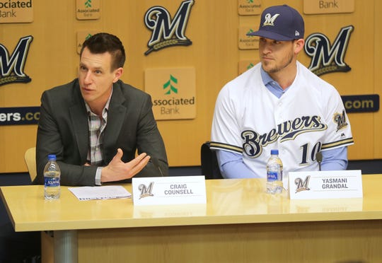 Brewers manager Craig Counsell answers questions about his new catcher, Yasmani Grandal (right), at a news conference at Miller Park Tuesday morning.